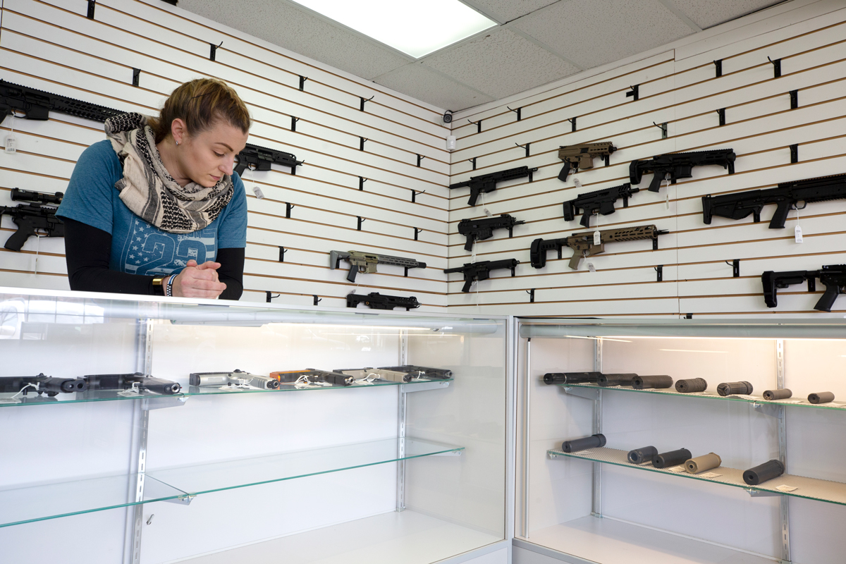 LYNNWOOD, WA - APRIL 02: Tiffany Teasdale, owner of Lynnwood Gun, looks down at mostly empty shelves on April 2, 2020 in Lynnwood, Washington. Washington State Governor Jay Inslee did not list gun stores as essential businesses that can stay open in his Stay-at-Home order to prevent the spread of coronavirus (COVID-19). However, Teasdale and some other gun retail shops say they are following orders by President Trump and state Republicans who advise that the firearms industry can remain open. Second Amendment gun rights advocacy groups are challenging governors orders around the country to remain open. (Photo by Karen Ducey/Getty Images)