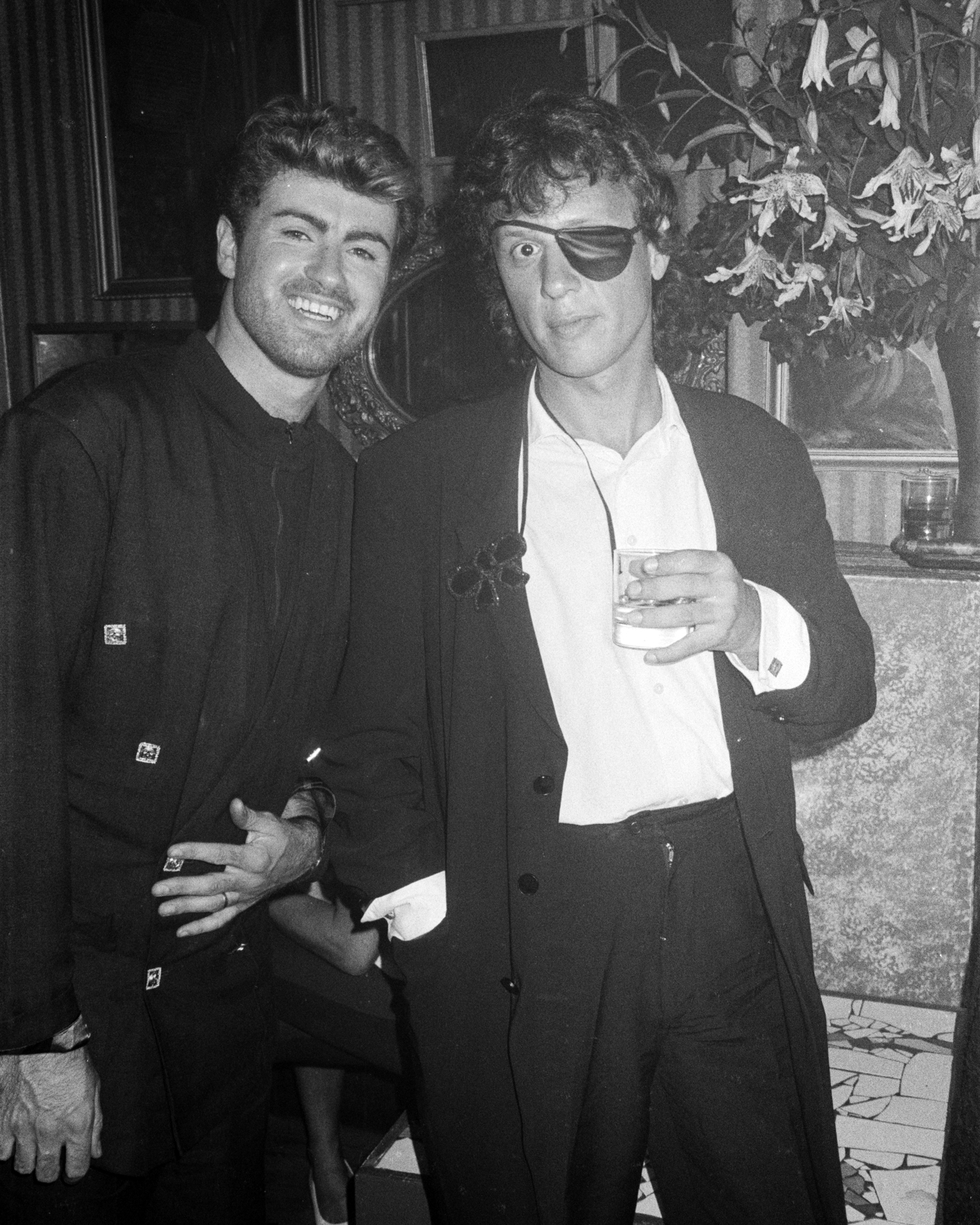 Canadian nightclub owner Peter Gatien (right) with English singer George Michael (1963 - 2016) in New York City, USA, circa 1987. (Photo by Michael Ochs Archives/Getty Images)