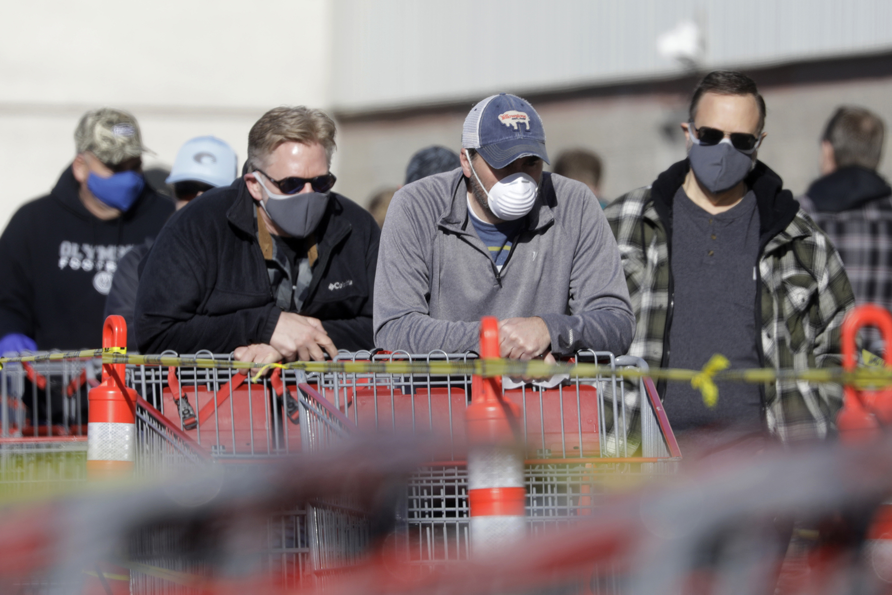 People wear masks as they wait in line at Costco, in Salt Lake City. The Centers for Disease Control and Prevention is now advising Americans to voluntarily wear a basic cloth or fabric face mask to help curb the spread of the new coronavirusVirus Outbreak Utah, Salt Lake City, United States - 04 Apr 2020