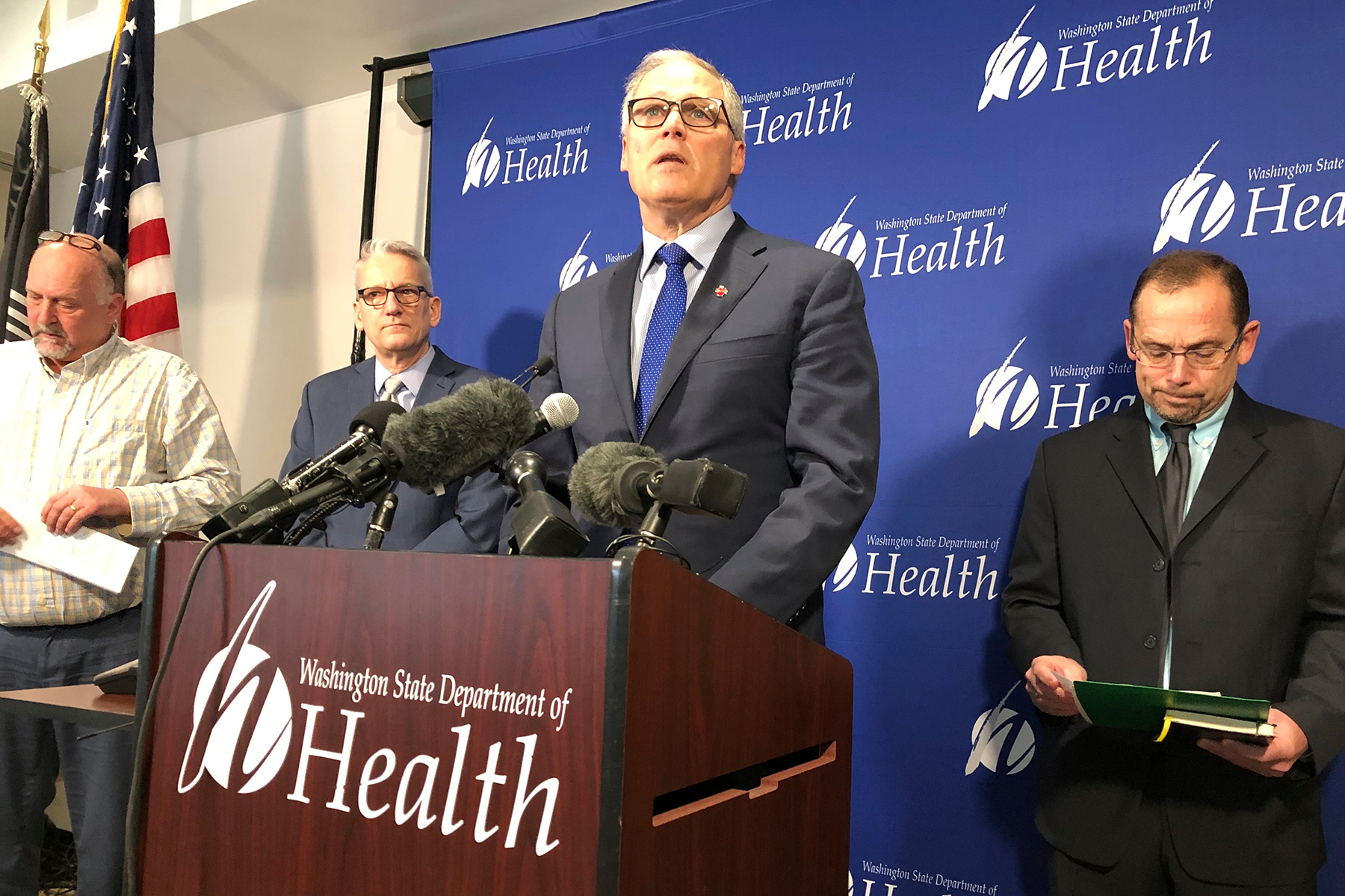 Washington Gov. Jay Inslee, center, speaks, at a news conference in Shoreline, Wash., following the announcement that a man in Washington state is the first known person in the United States to catch a new type of coronavirus that officials believe originated in China. The man who caught the virus is a Washington state resident who returned last week from China and is currently hospitalized near SeattleChina Outbreak, Shoreline, USA - 21 Jan 2020