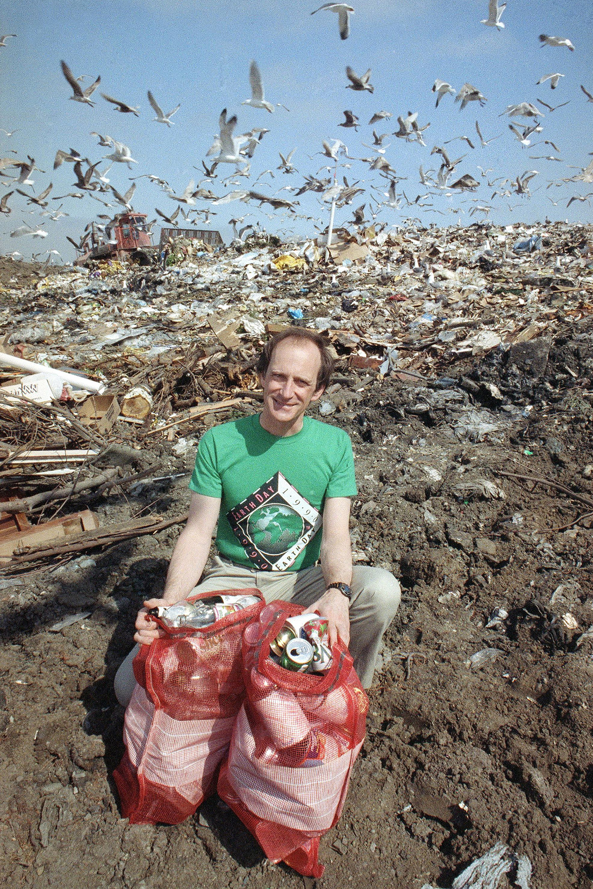 Denis Hayes Earth Day founder and Palo Alto, California resident Denis Hayes at a dump site in Palo Alto, California, as he displays burlap sacks filled with empty glass bottles and metal cans that local residents use in a weekly recycling program. Hayes urges all people to recycle as an alternative to dumpingDenis Hayes at dump site, Palo Alto, USA
