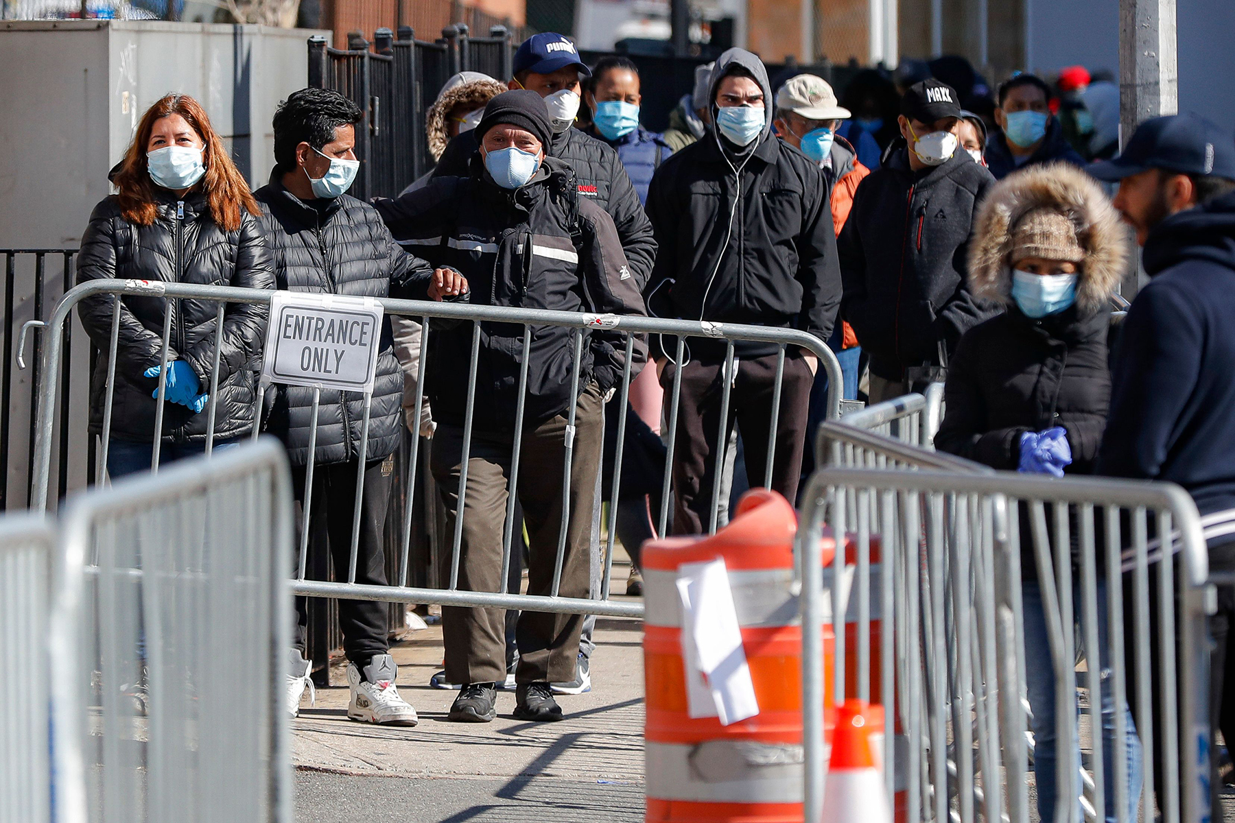 Patients wearing face masks and personal protective equipment wait on line for COVID-19 testing outside Elmhurst Hospital Center, in New York. The new coronavirus causes mild or moderate symptoms for most people, but for some, especially older adults and people with existing health problems, it can cause more severe illness or deathVirus Outbreak , New York, United States - 27 Mar 2020