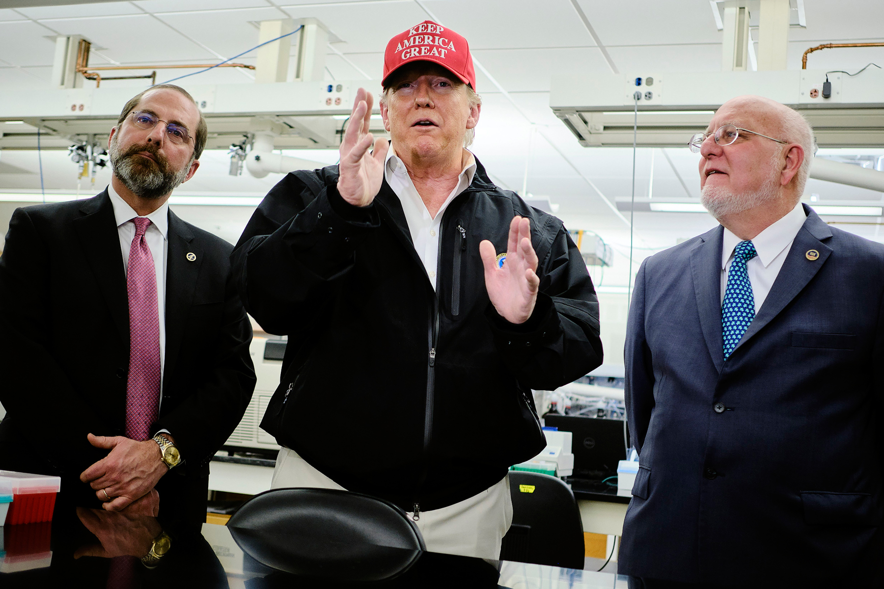 President Donald Trump, accompanied by Health and Human Services Secretary Alex Azar, left, Centers for Disease Control and Prevention Director Dr. Robert Redfield, right, speaks during a visit to the CDC in Atlanta, Friday, March 6, 2020. Trump signed an $8.3 billion emergency spending bill to confront the coronavirus outbreak on Friday morning and decided to visit the CDC in Atlanta, reversing his decision hours earlier to skip touring the nerve center of the government's response to the health crisis. (T.J. Kirkpatrick/The New York Times)