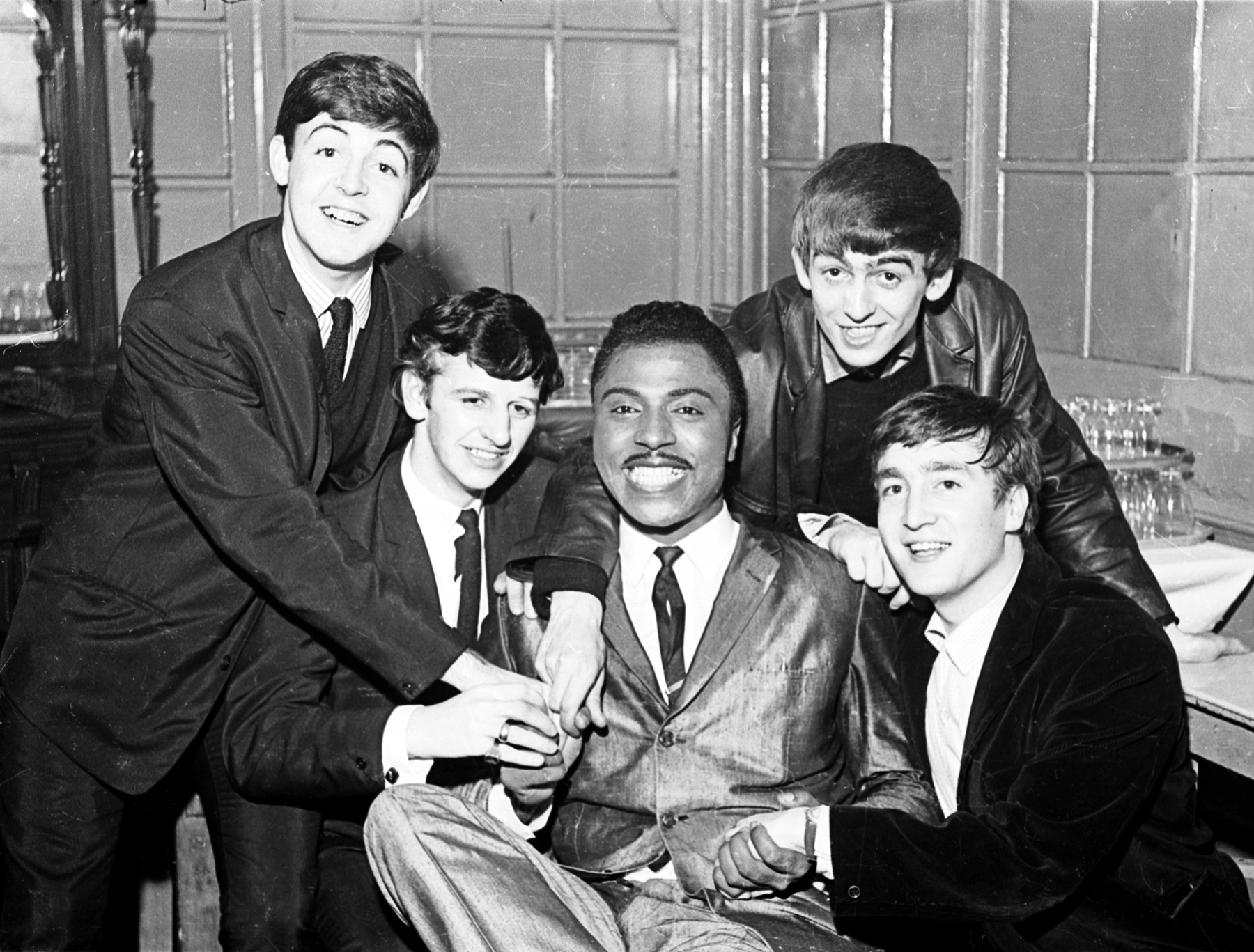 The Beatles pose with Little Richard backstage at the Tower Ballroom in New Brighton, October 12, 1962.credit: (c) Apple Corps Ltd.