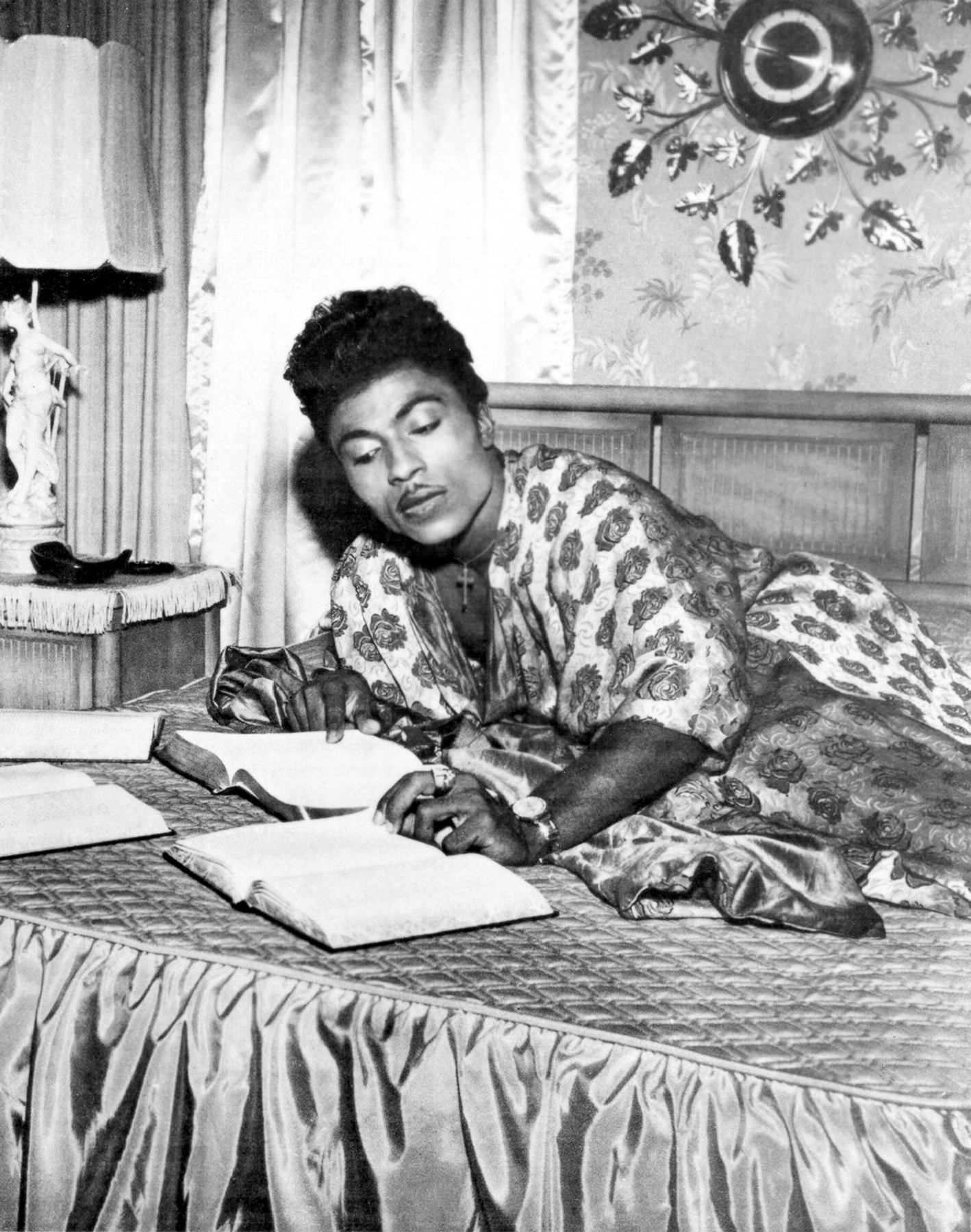 1958: Rock and roll singer Little Richard studies the bible on his bed in 1958 as he quit rock and roll to attend bible school. (Photo by Michael Ochs Archives/Getty Images)