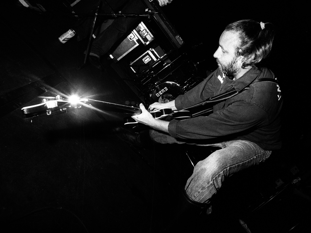 Peter Hook, performs on stage during a tour with his band Revenge, United Kingdom, 1990. (Photo by Martyn Goodacre/Getty Images)