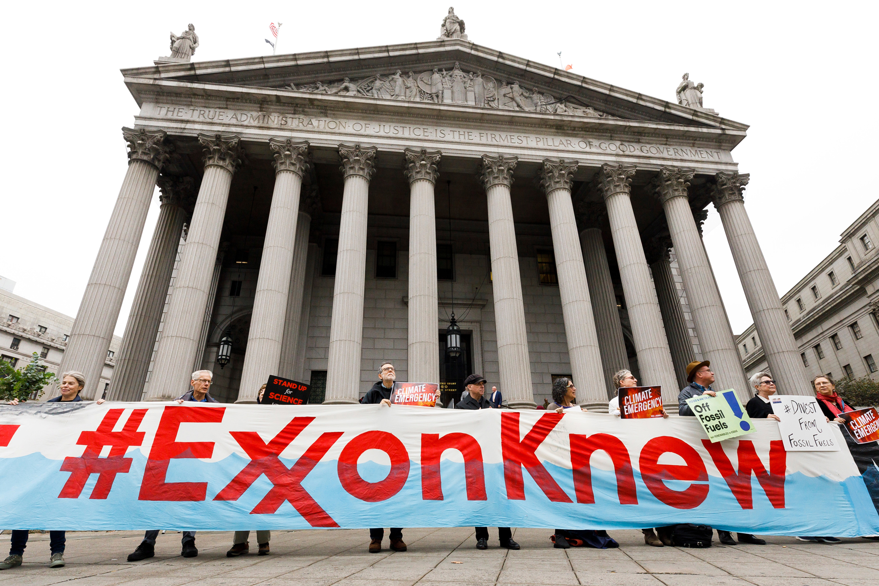 A group of protestors gather outside of a New York City courthouse for a rally coinciding with the start of a legal case against Exxon Mobile on October 22nd, 2019 in New York.