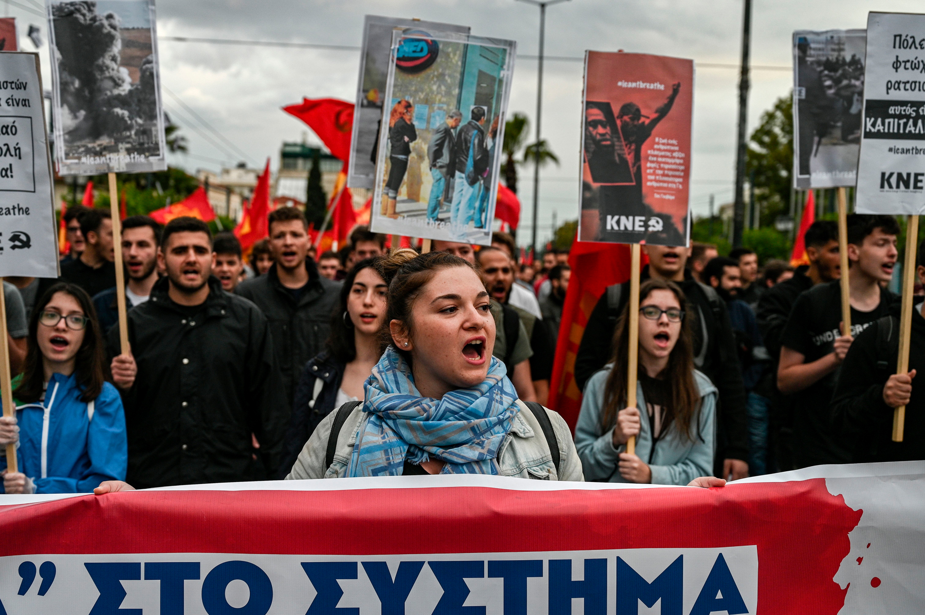Youth members of the greek Comunist party protest next to the US embassy in Athens over the police killing of George Floyd in the USA, on June 1, 2020. - The United States has erupted into days and nights of protests, violence, and looting, following the death of George Floyd after he was detained and held down by a knee to his neck, dying shortly after. (Photo by ARIS MESSINIS / AFP) (Photo by ARIS MESSINIS/AFP via Getty Images)