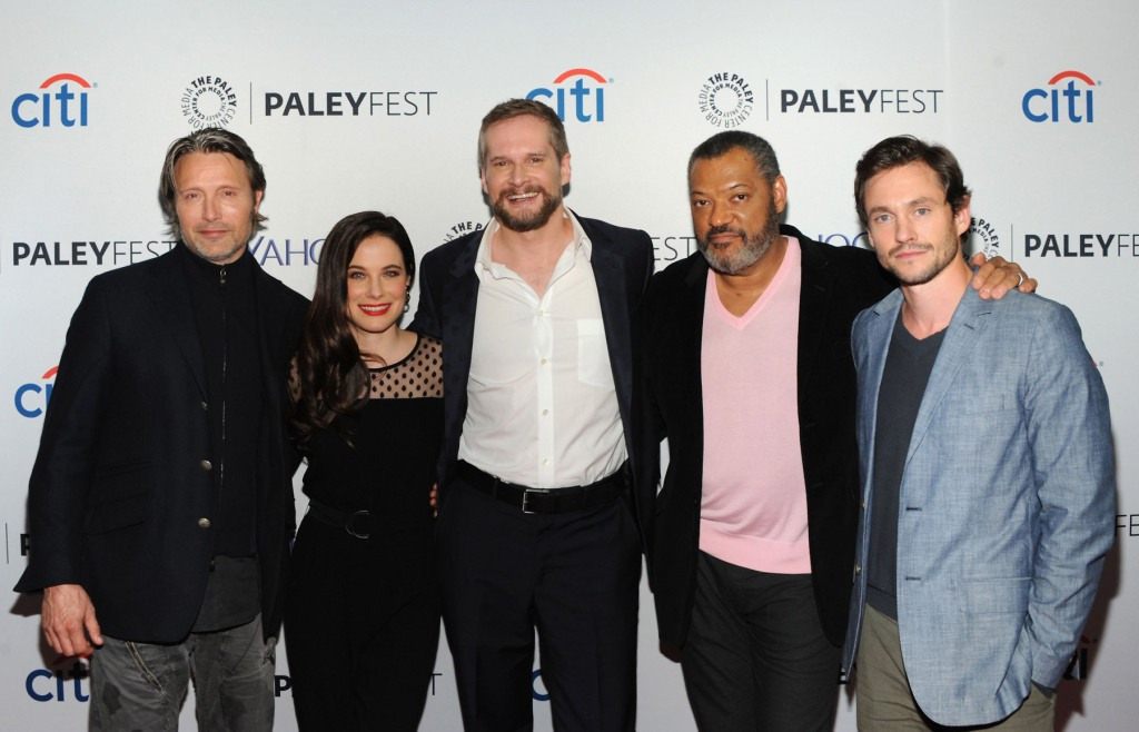 "NEW YORK, NY - OCTOBER 18: (L-R) Mads Mikkelsen, Caroline Dhavernas, Bryan Fuller, Laurence Fishburne and Hugh Dancy attend the 2nd annual Paleyfest New York presents: ""Hannibal"" at Paley Center For Media on October 18, 2014 in New York, New York. (Photo by Andrew Toth/Getty Images)"