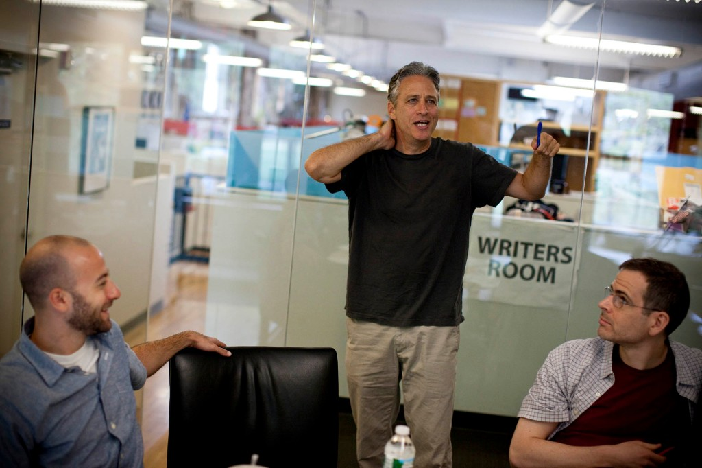 """NEW YORK, NY - AUGUST 9 : Comedian Jon Stewart, host of Comedy Central's The Daily Show, works with script writers in the show's """"writer's room,"""" on August 9, 2011 in New York. (Photo by Benjamin Lowy/Getty Images)"""