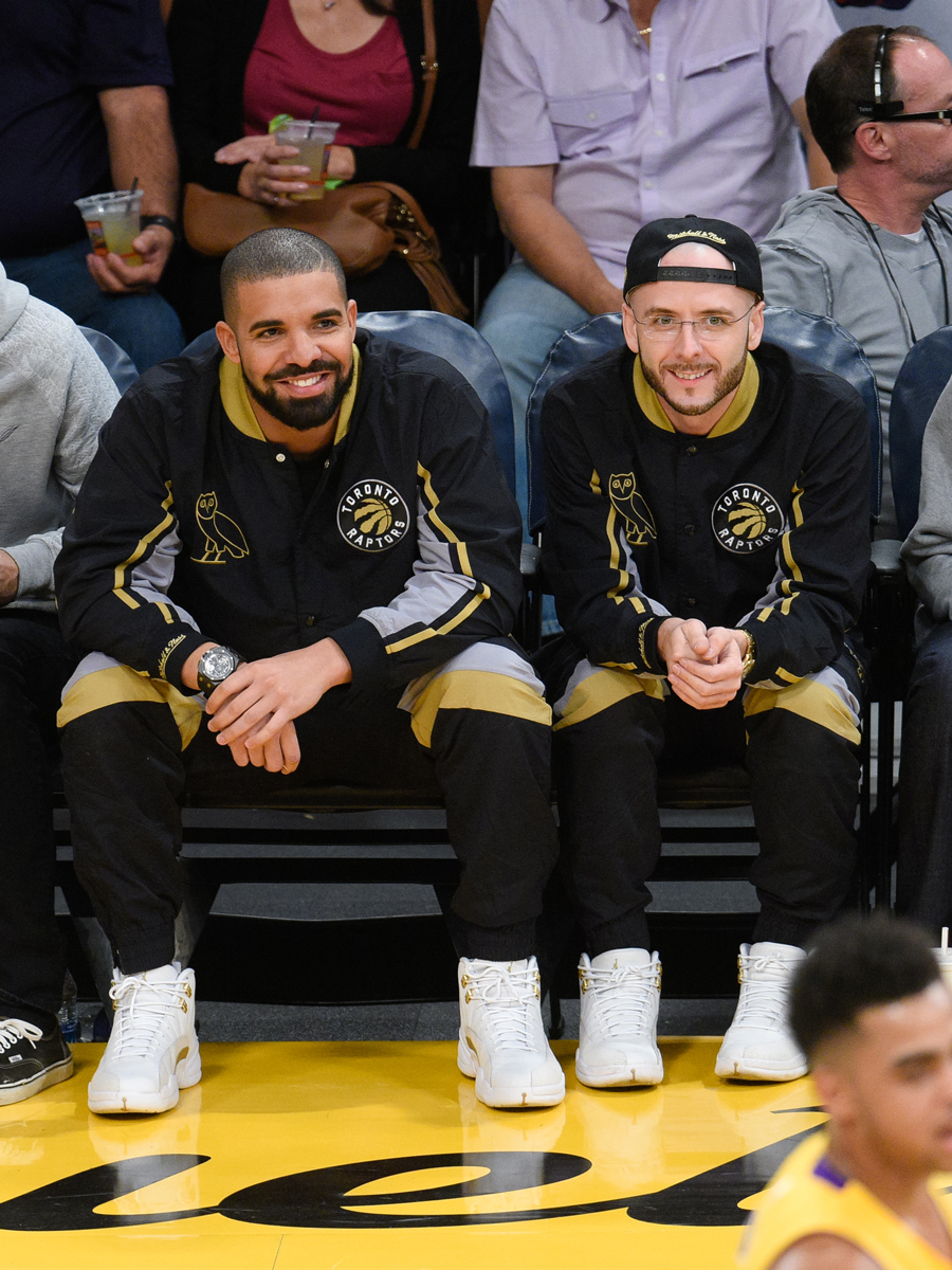 Drake and Noah Shebib attend a basketball game between the Toronto Raptors and the Los Angeles Lakers at Staples Center on November 20, 2015 in Los Angeles, California.