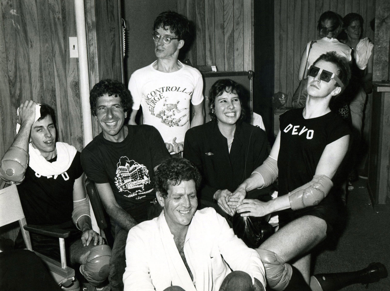 Leonard Cohen, David Blue (seated), Devo, and Martine Getty backstage at The Starwood in Los Angeles, Calfornia, 1978.