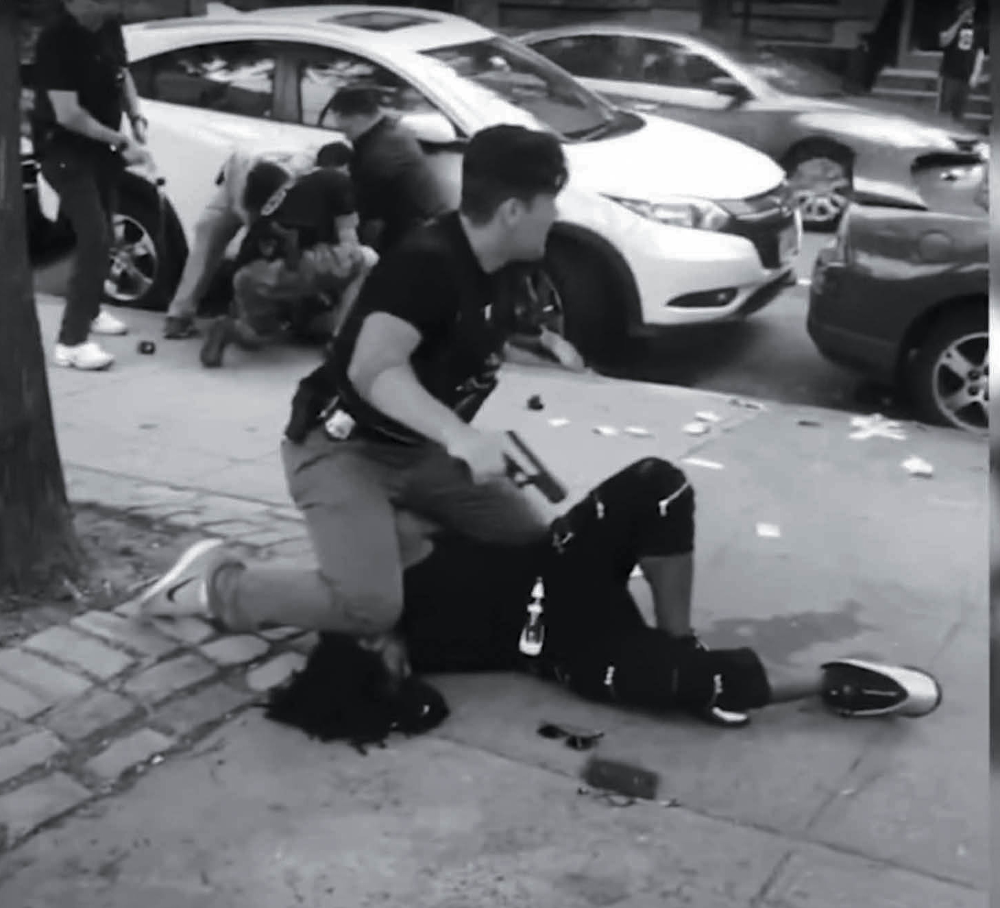 an NYPD cop knees the head of a suspect in 2019