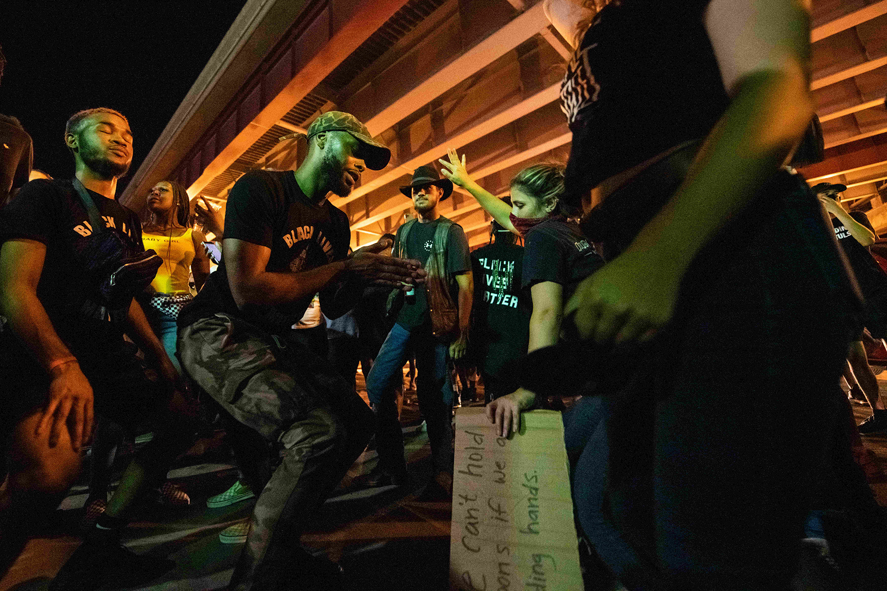 June 20, 2020, Tulsa, Oklahoma, USA: After President Trumps Rally in Tulsa a large group of protesters assembled just steps away from the BOK Center. The peaceful demonstration was met with hoards of police and a swarm of pepper bullets. As th police retreated from the raucous crowd the protesters decided to move back to the Greenwood District, and Black Wall Street, the site of the 1921 race massacre in Tulsa. Upon arriving back in Greenwood the protesters were met by a DJ that happened to be playing on Black Wall Street. The large crowd of demonstrators, made of many different races and backgrounds celebrated one anothers differences and danced into the early morning hours. They spoke of how Trumps rally was divisive and exclusive, but their rally in Greenwood was all inclusive and how they would defeat hate with love. The beautifully organic moment where time seemingly stood still for the protesters was filled with love, and celebration for they felt that they were winning this battle by not engaging in hate. (Credit Image: © Tyler Tomasello/ZUMA Wire)