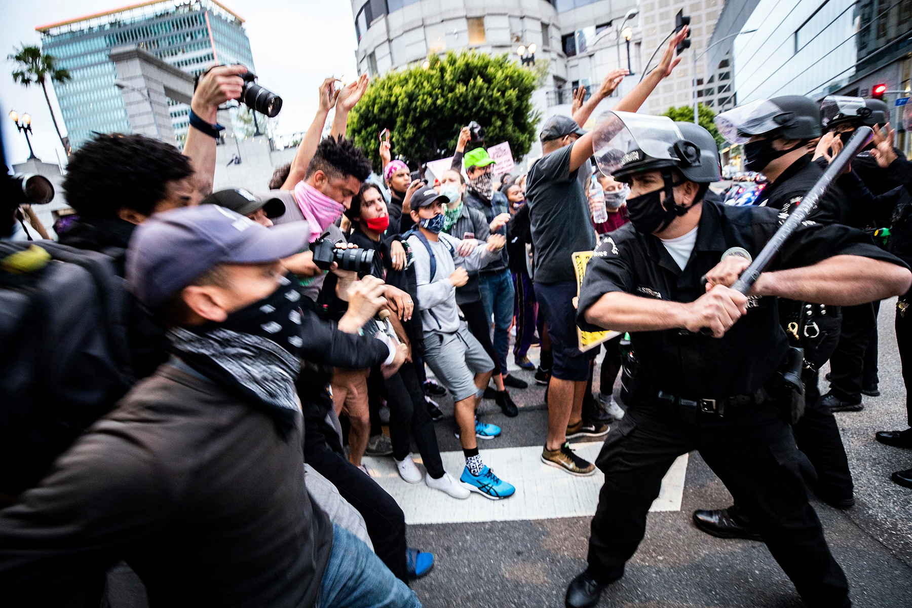 A police officer reacts as protesters try to break through a police blockade during protests over the Minnesota arrest of George Floyd, who later died in police custody, in Los Angeles, California, USA, 29 May 2020. A bystander's video posted online on 25 May, appeared to show George Floyd, 46, pleading with arresting officers that he couldn't breathe as an officer knelt on his neck. The unarmed black man later died in police custody. On 29 May, Hennepin County Attorney Mike Freeman announced third degree murder charges against the Minneapolis police officer who killed George Floyd.Police abuse protest in wake of George Floyd death, in Los Angeles, USA - 29 May 2020