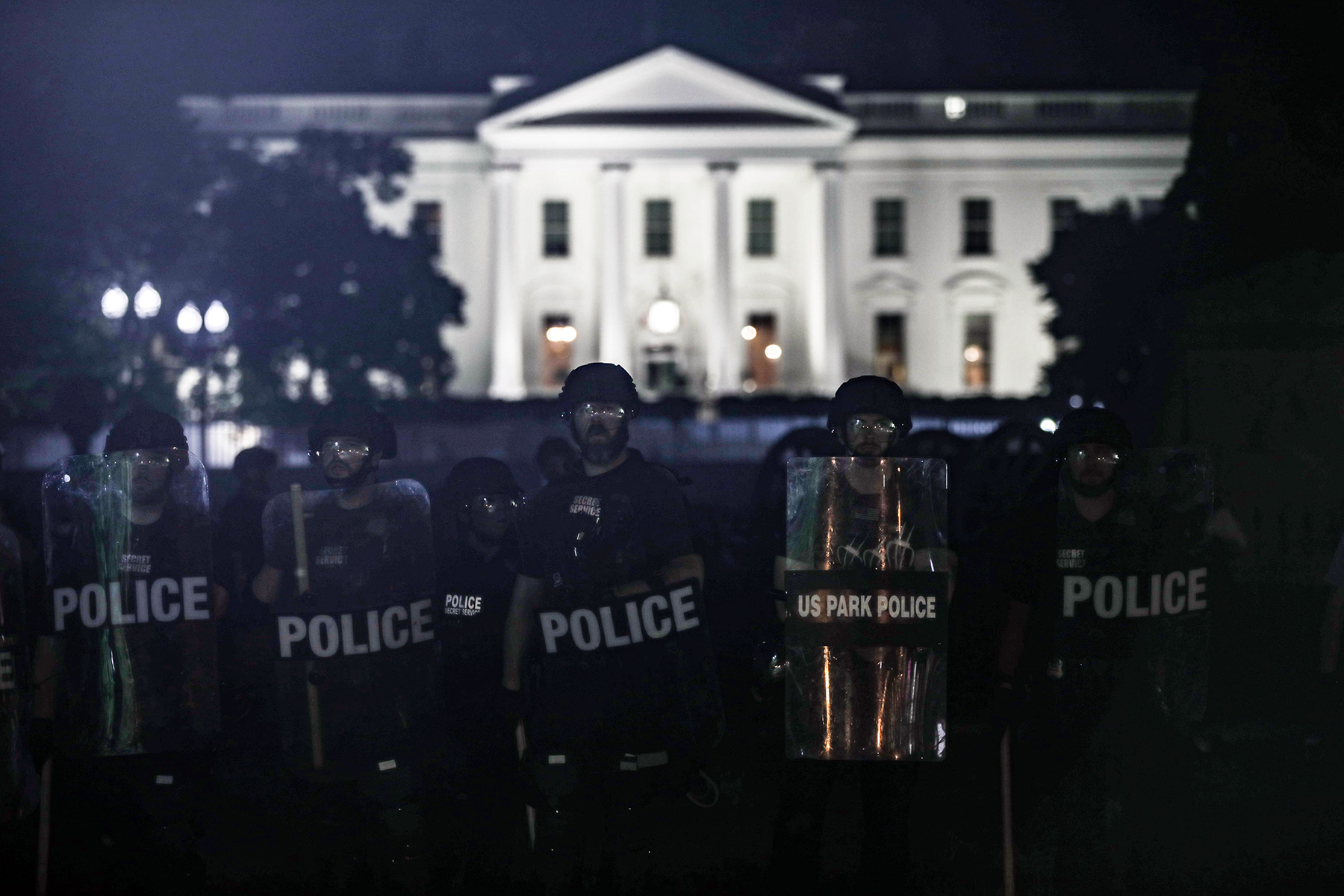 WASHINGTON, USA - JUNE 1: Police take security measures near White House during a protest over the death of George Floyd, an unarmed black man who died after being pinned down by a white police officer in Washington, United States on June 1, 2020. (Photo by Yasin Ozturk/Anadolu Agency via Getty Images)