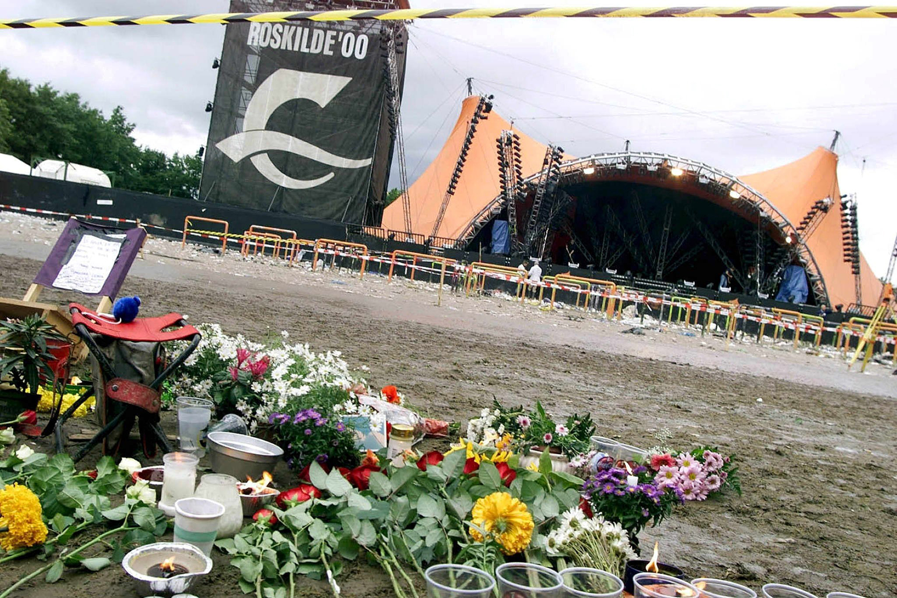 Roskilde Denmark: Flowers Lighted Candles and Other Tributes Mark the Spot Saturday 1st July 2000 Near where Late Yesterday Eight Young Men Were Trampled to Death During a Concert by the American Pearl Jam Band As Part of the Roskilde Rock Festival in Denmark So Far Four Have Been Identified As Coming From Denmark Sweden Holland and Germany Epa Photo/nordfoto/brian Rasmussen Denmark RoskildeDenmark-concert-deaths - Jul 2000