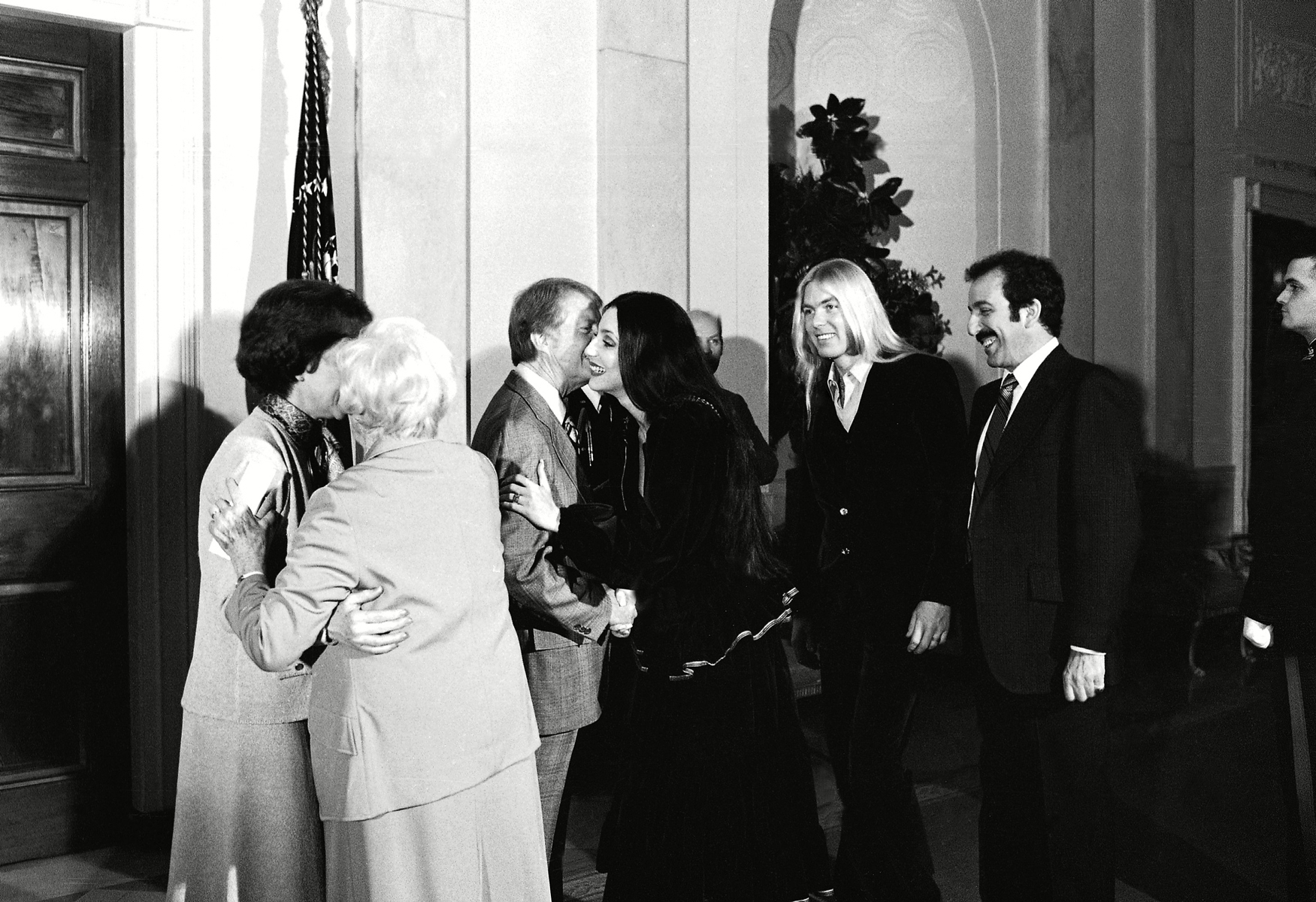 President Jimmy Carter greets singer Cher as her husband Gregg Allman stands by, second from right, during a reception at the White House in Washington in 1977.