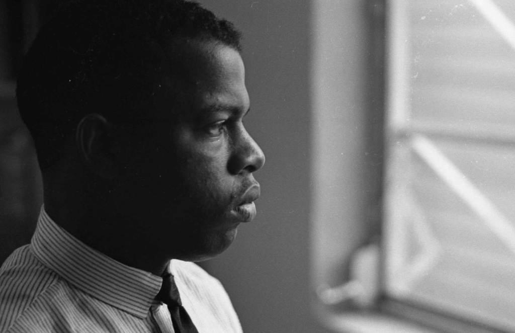 Close-up of American Civil Rights activist (and future politician) John Lewis, chairman of the Student Non-Violent Coordinating Committee (SNCC), in an office, New York, 1964. (Photo by Robert Elfstrom/Villon Films/Gety Images)