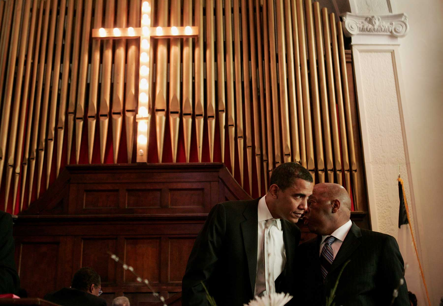 SELMA, AL - MARCH 4: Democratic Presidential candidate Senator Barack Obama (D-IL) (L) speaks with U.S. congressman John Lewis (D-GA) before addressing a crowd gathered for the commemoration of the 1965 Voting Rights March at Brown Chapel AME Church March 4, 2007 in Selma, Alabama. During the 1965 march, which was to go from Selma to Montgomery, Alabama, police used tear gas and beat back the marchers when they reached the Pettus Bridge. (Photo by Scott Olson/Getty Images)