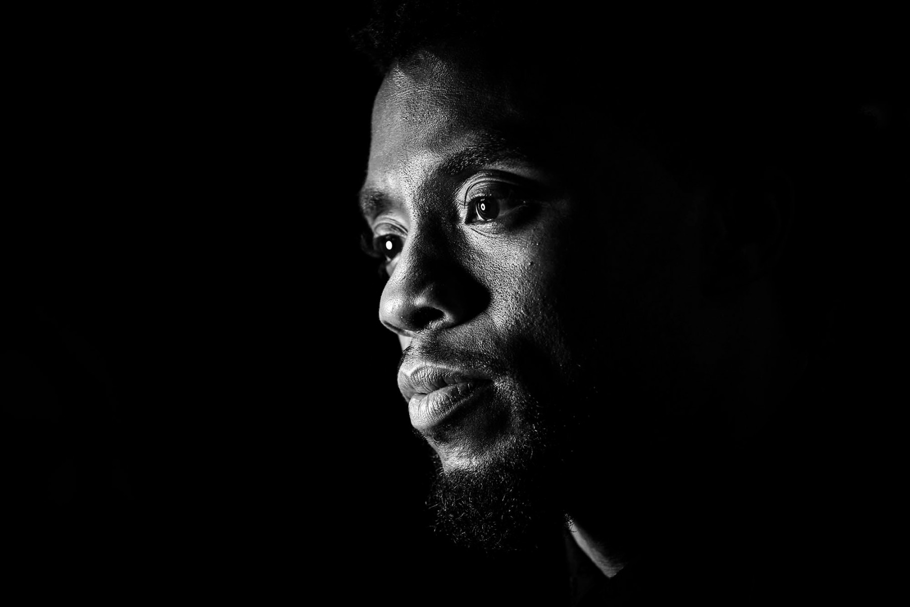"LONDON, ENGLAND - FEBRUARY 08:  (EDITORS NOTE: THIS IMAGE HAS BEEN CONVERTED TO BLACK AND WHITE) Chadwick Boseman attends the European Premiere of Marvel Studios' ""Black Panther"" at the Eventim Apollo, Hammersmith on February 8, 2018 in London, England.  (Photo by Gareth Cattermole/Getty Images for Disney)"