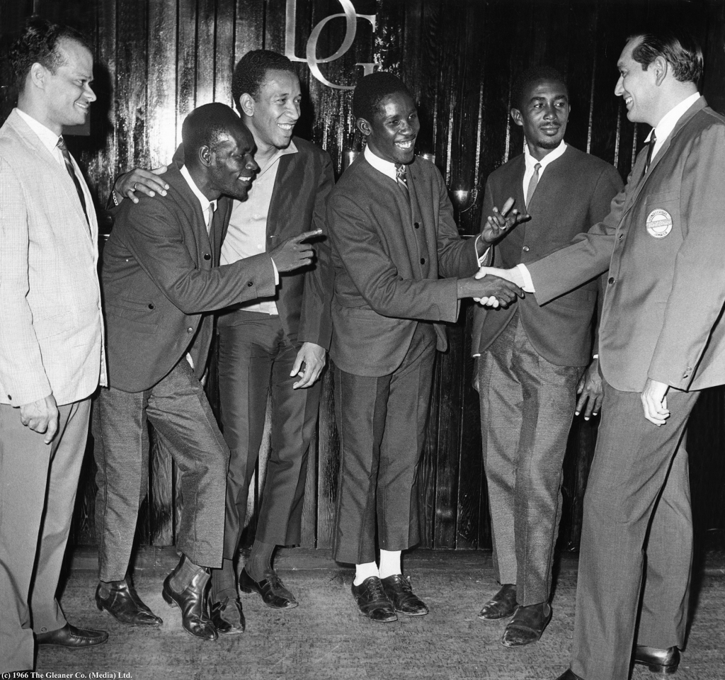 "Gleaner PhotoJAMAICA FESTIVAL SONG WINNERS: Frederick Hibbert, leader of the Maytals, being congratulated on behalf of the singing group by Mr. Jim Lim, sale manager of Desnoes and Geddes, sponsors of the Song for Jamaica Festival, on Friday night (July 1, 1966) in the D & G Hospitality Room. Looking on (from left) are Mr. Hugh Nash, Festival Officer, Henry Gordon of the Maytals, Derrick Harriott, second prize winner with the song ""Festival Our Time fe Celebrate"", and Nathaniel McCarthy, also of the Maytals. *** Local Caption *** Gleaner Photo JAMAICA FESTIVAL SONG WINNERS: Frederick Hibbert, leader of the Maytals, being congratulated on behalf of the singing group by Mr. Jim Lim, sale manager of Desnoes and Geddes, sponsors of the Song for Jamaica Festival, on Friday night (July 1, 1966) in the D & G Hospitality Room. Looking on (from left) are Mr. Hugh Nash, Festival Officer, Henry Gordon of the Maytals, Derrick Harriott, second prize winner with the song ""Festival Our Time fe Celebrate"", and Nathaniel McCarthy, also of the Maytals."