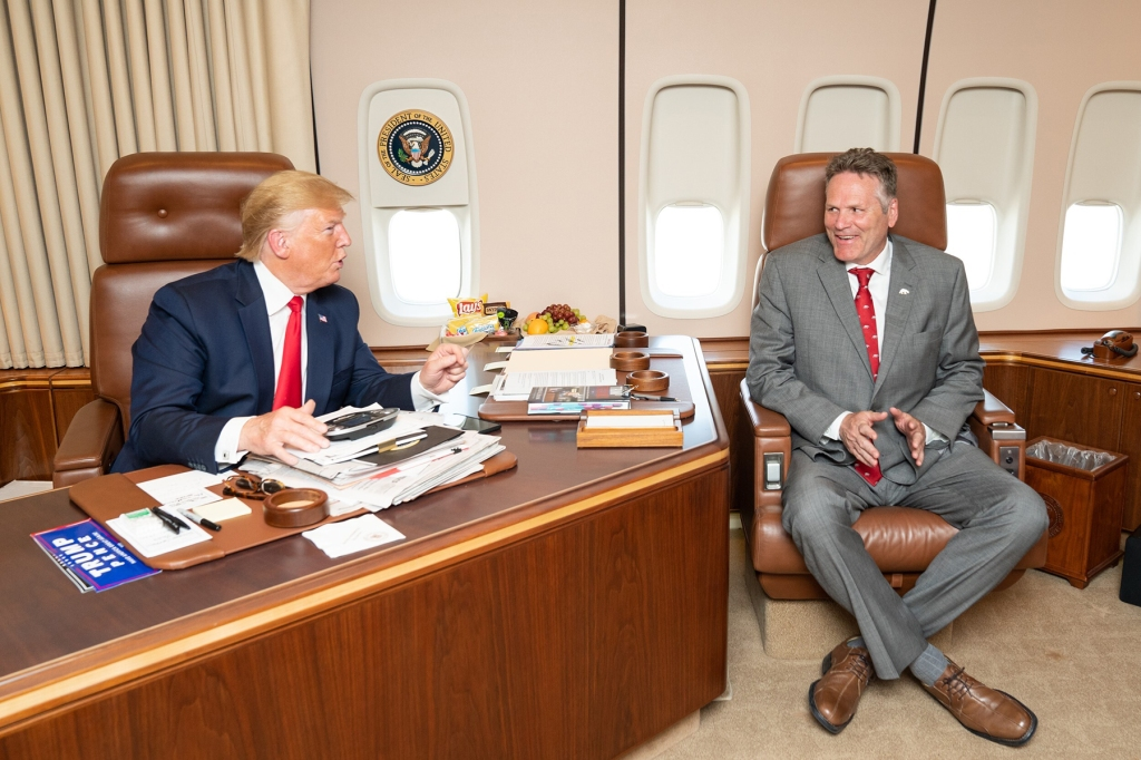 Alaska Gov. Mike Dunleavy meets with President Donald Trump on Air Force One during a layover at Joint Base Elmenorf-Richardson in Anchorage, June 26, 2019. (Photo by Sheila Craighead/White House)
