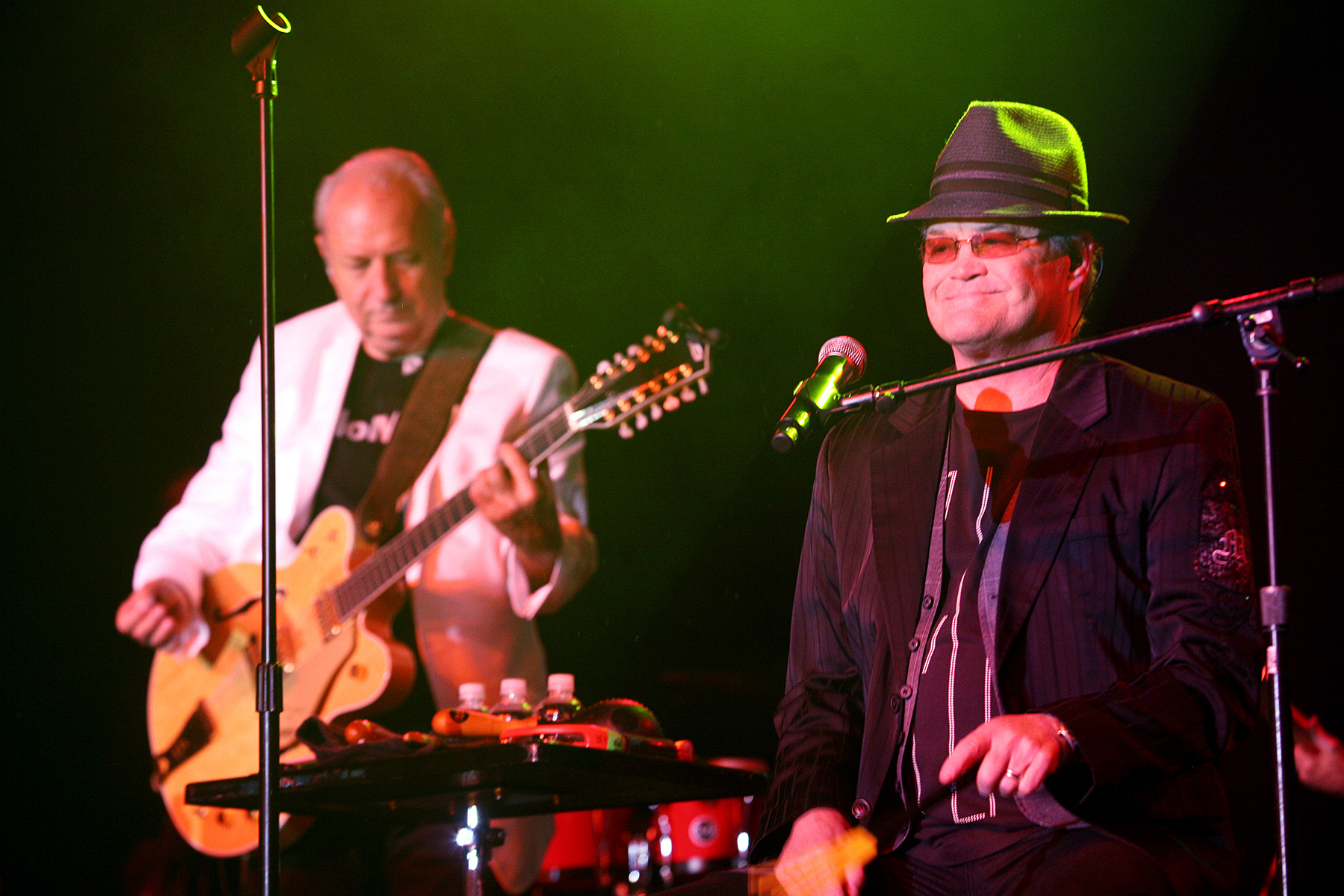 LAS VEGAS - AUGUST 10:  In this photo provided by the Las Vegas News Bureau, Michael Nesmith and Micky Dolenz of The Monkees perform at Green Valley Ranch on August 10, 2013 in Las Vegas, Nevada. (Photo by George Bekich II/Las Vegas News Bureau via Getty Images)