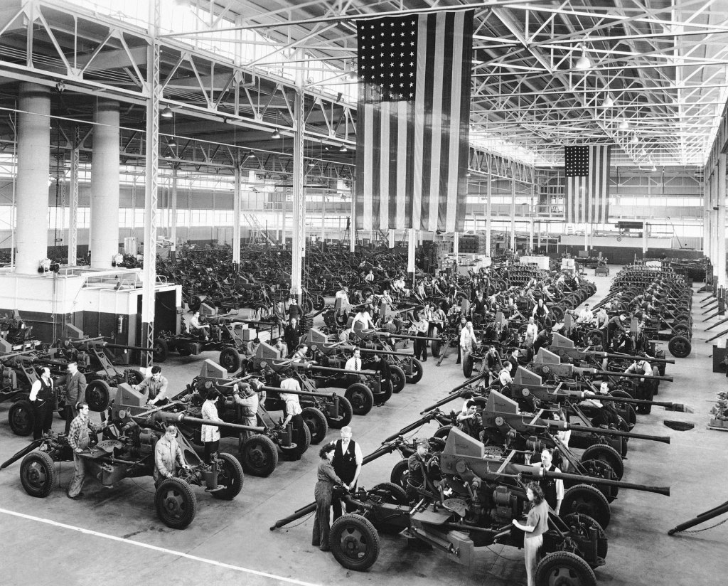FILE - In this April 3, 1944, file photo Bofors guns used by the Army and Navy are shown lined up at the Firestone Tire & Rubber Co. in Akron, Ohio. Not since World War II when factories converted from making automobiles to making tanks, Jeeps and torpedos has the entire nation been asked to truly sacrifice for a greater good. (AP Photo, File)