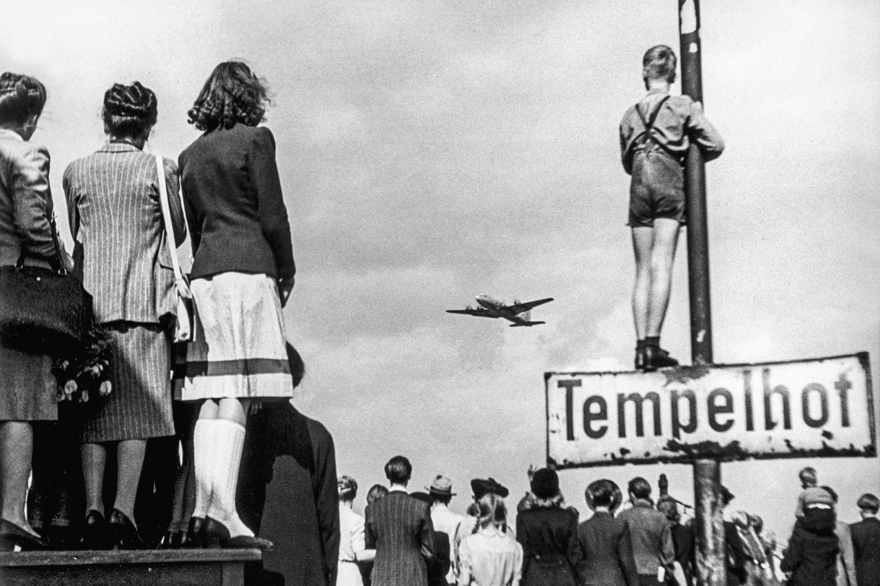 At Tempelhof airport, Berliners watching aeroplanes during the airlift during the blockade of Berlin, 1948.