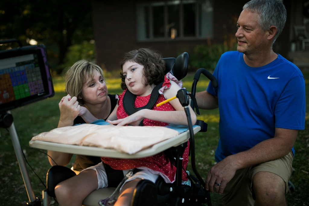Bella Yoder with her parents outside of their home in Sugar Creek, OH on September 8, 2020.