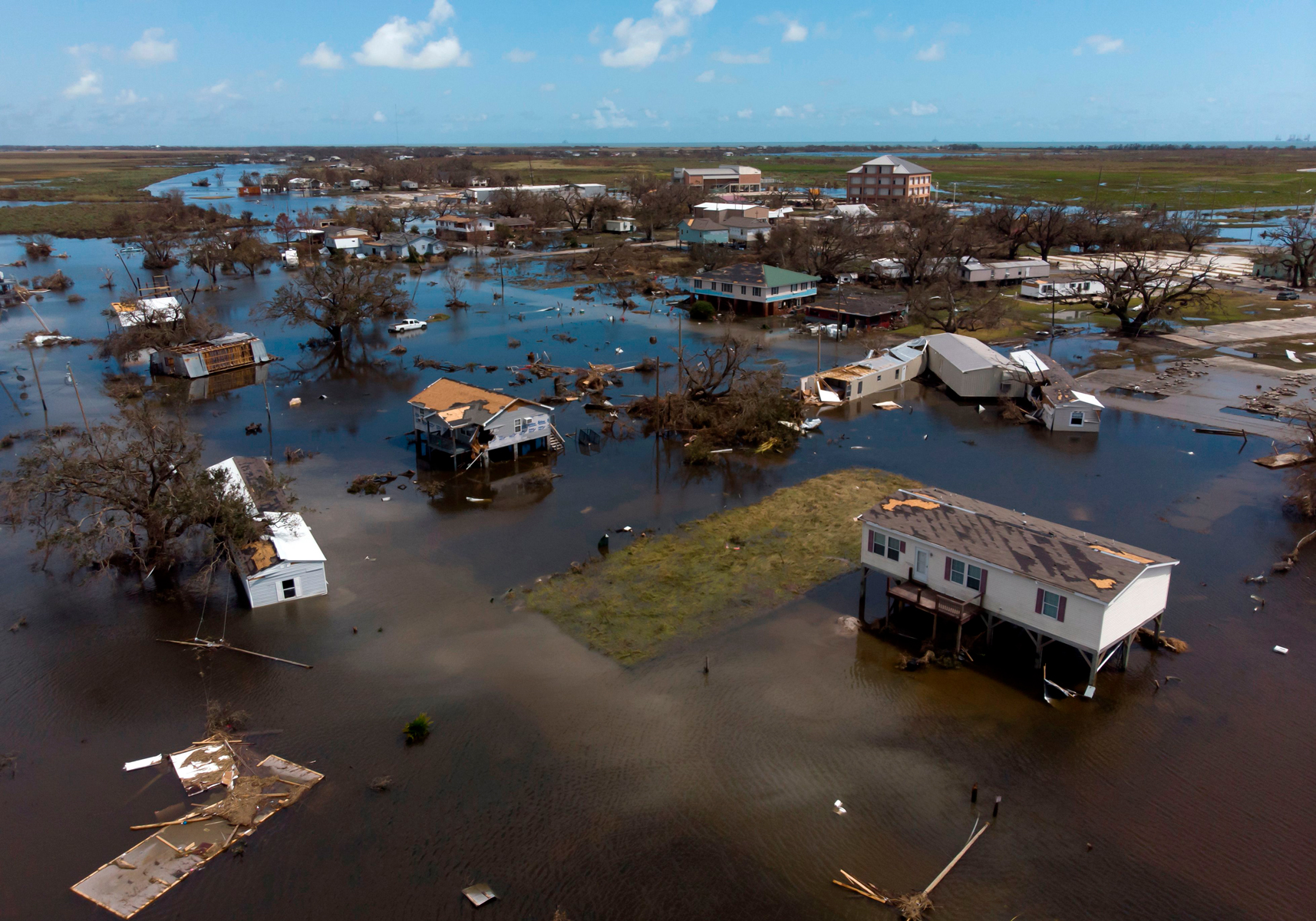 An aerial view shows homes that were destroyed by Hurricane Laura on August 29, 2020 in Cameron, Louisiana.
