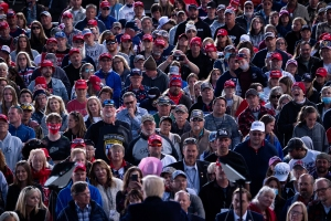 "People listen while US President Donald Trump (bottom C) speaks during a ""Great American Comeback"" rally at Bemidji Regional Airport in Bemidji, Minnesota, on September 18, 2020. (Photo by Brendan Smialowski / AFP) (Photo by BRENDAN SMIALOWSKI/AFP via Getty Images)"