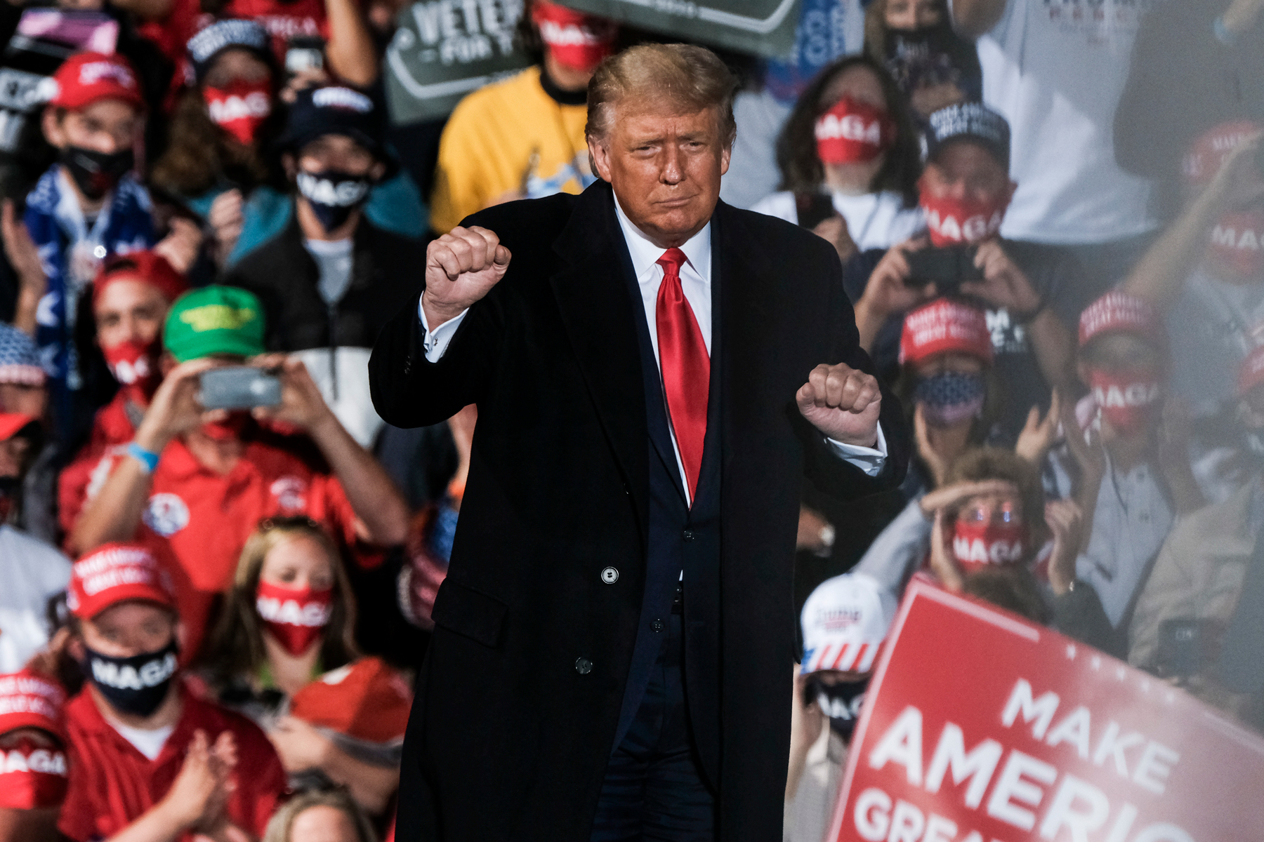 President Donald Trump charges up the crowd while speaking of the need to win the upcoming election during a campaign rally at the Toledo Express Airport on September 21, 2020 in Swanton, Ohio. Through the rally the President both expressed the importance of filling the late Supreme Court Justice Ruth Bader Ginsberg's seat as well as his perceived consequences to America if his opponent Joe Biden were to win in the upcoming election.