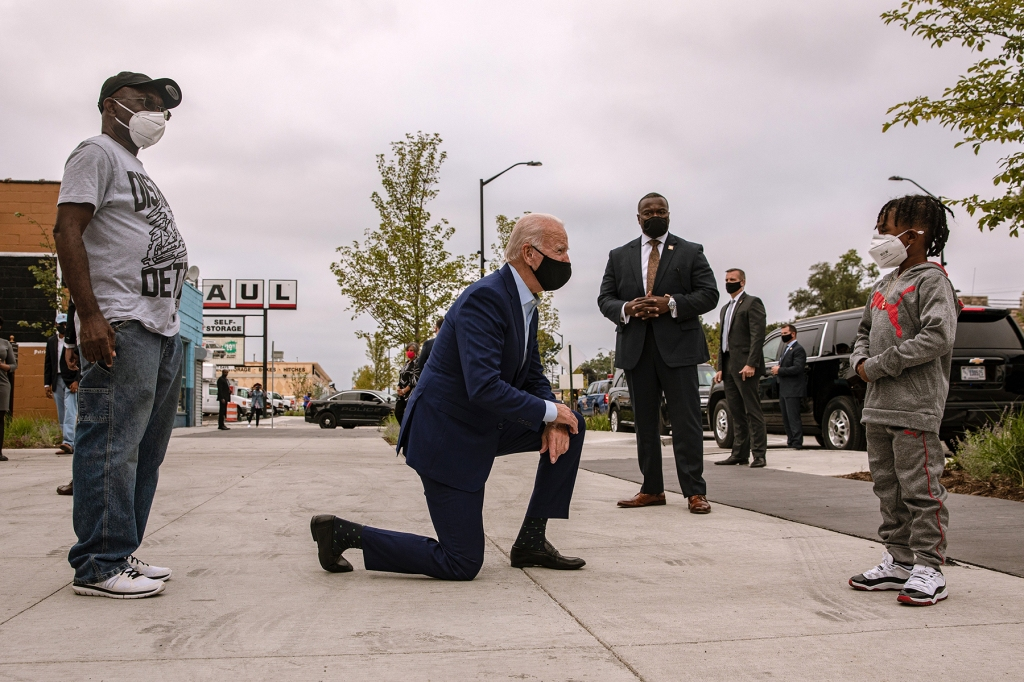 Joe Biden, the Democratic presidential nominee, speaks with CJ Brown, son of Clement Brown, left, owner of a local clothing store in Detroit, Wednesday, Sept. 9, 2020. (Amr Alfiky/The New York Times)