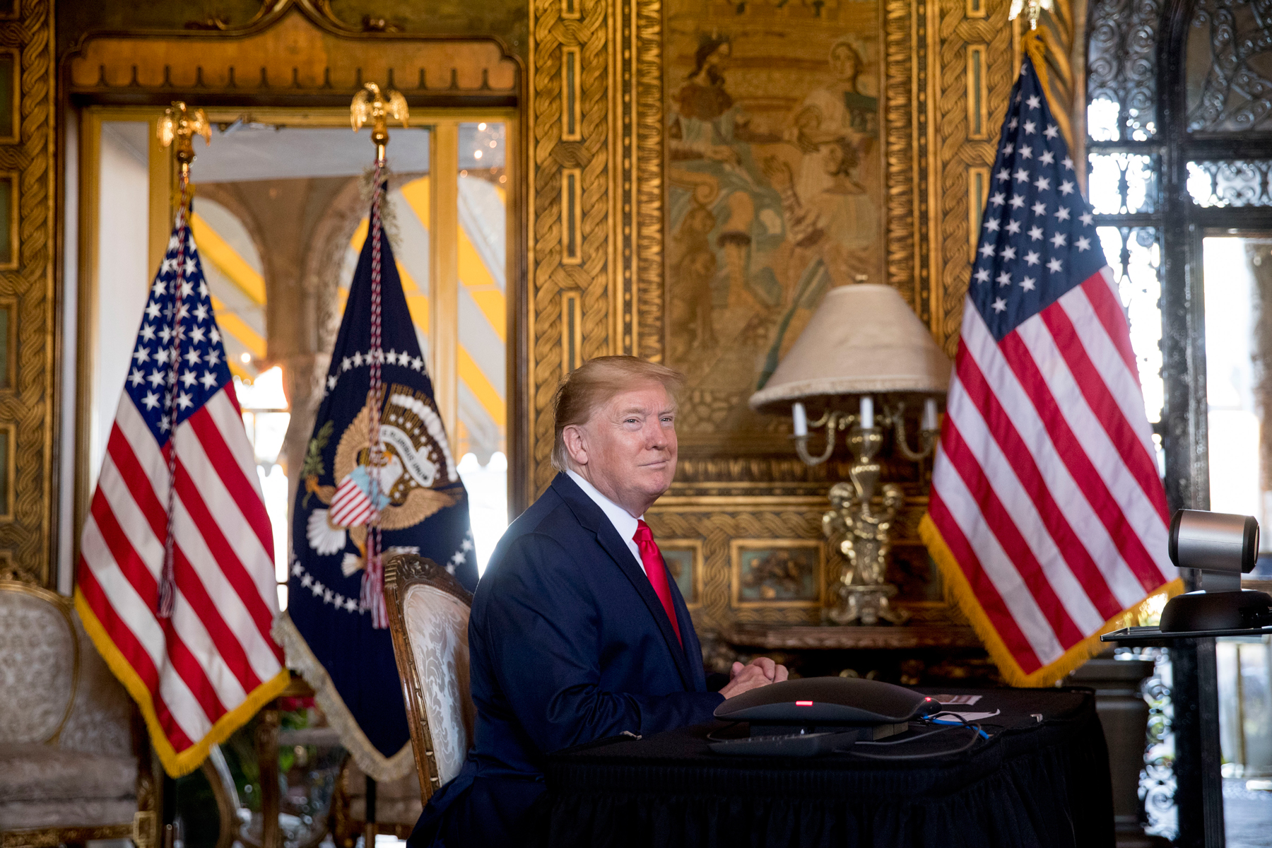 President Donald Trump looks towards members of the media as he speaks during a Christmas Eve video teleconference with members of the military at his Mar-a-Lago estate in Palm Beach, Fla., Tuesday, Dec. 24, 2019. (AP Photo/Andrew Harnik)