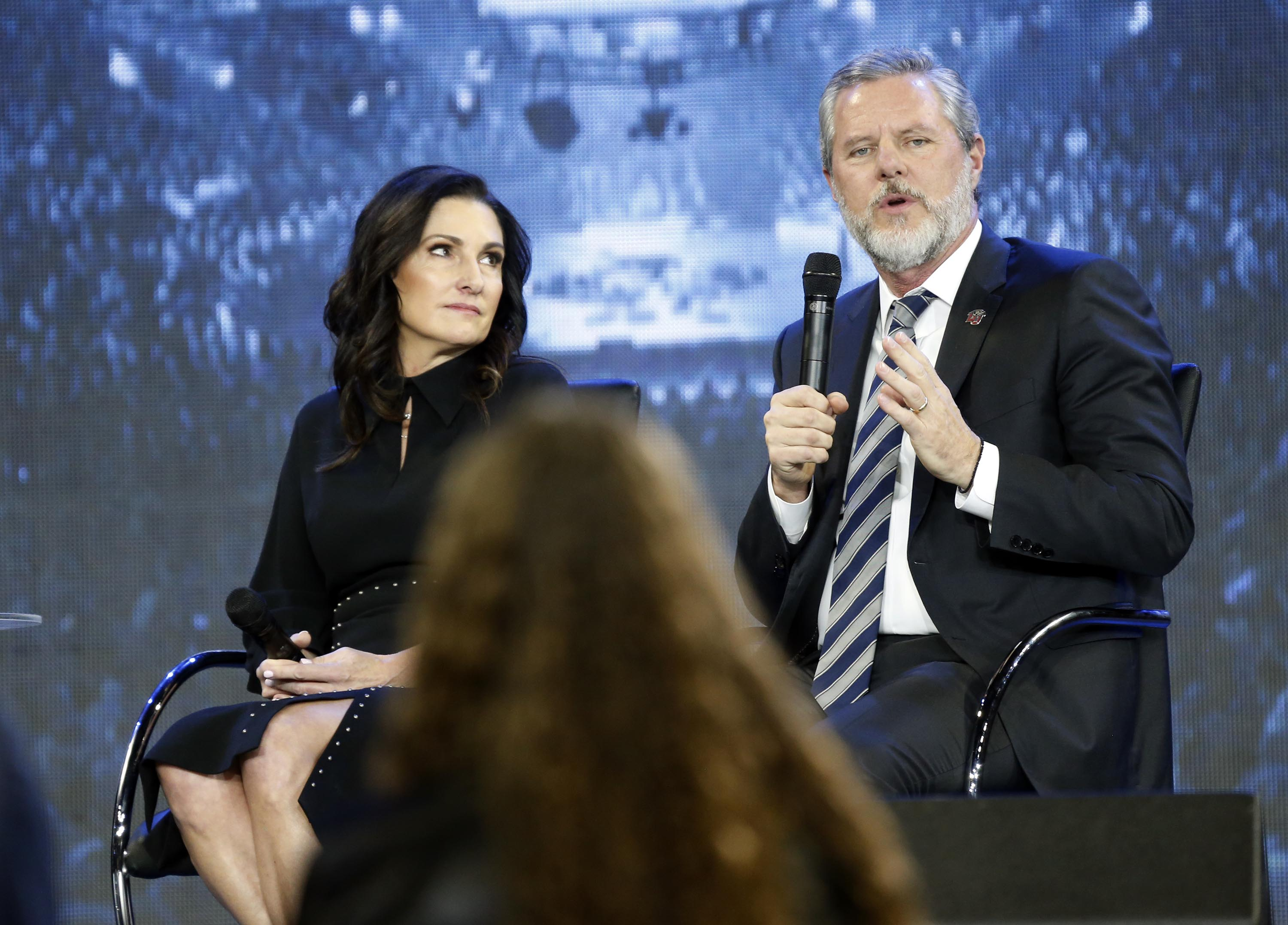 FILE - In this Nov. 28, 2018 file photo, Jerry Falwell Jr., right, answers a students question accompanied by his wife, Becki, during after a town hall on the opioid crisis at a convocation at Liberty University in Lynchburg, Va. Jerry Falwell Jr., who leads the prominent evangelical Christian university, apologized in June 2020 after posting a tweet invoking the blackface scandal that engulfed Virginia's governor in 2019. But Falwell's rare show of contrition, which followed a rebuke from nearly three dozen Black Liberty alumni, has left many African American students, alumni and staff unconvinced of his interest in helping the school live up to its promises about diversity. (AP Photo/Steve Helber, File)