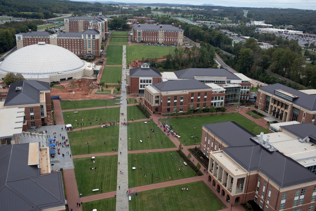 LYNCHBURG, VA - OCTOBER 20: Students mingle on the campus lawn at Liberty University on October 20, 2018 in Lynchburg, Virginia. Liberty University is one of America's premiere christian colleges, where religious faith is a central component of the educational curriculum. (Photo by Andrew Lichtenstein/Corbis via Getty Images)