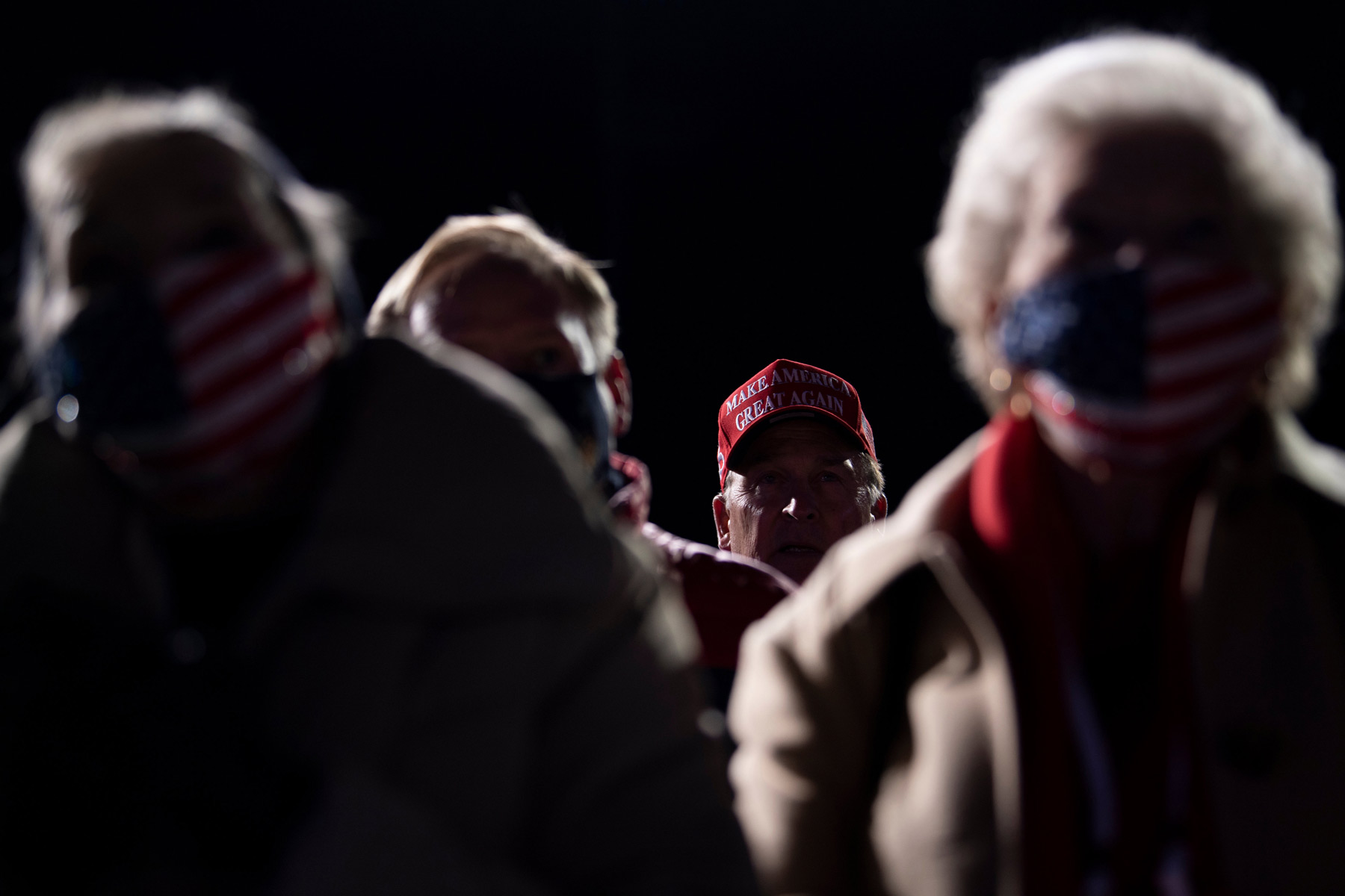 Supporters listen to US President Donald Trump speak at a Make America Great Again rally at Eppley Airfield on October 27, 2020, in Omaha, Nebraska. (Photo by Brendan Smialowski / AFP) (Photo by BRENDAN SMIALOWSKI/AFP via Getty Images)