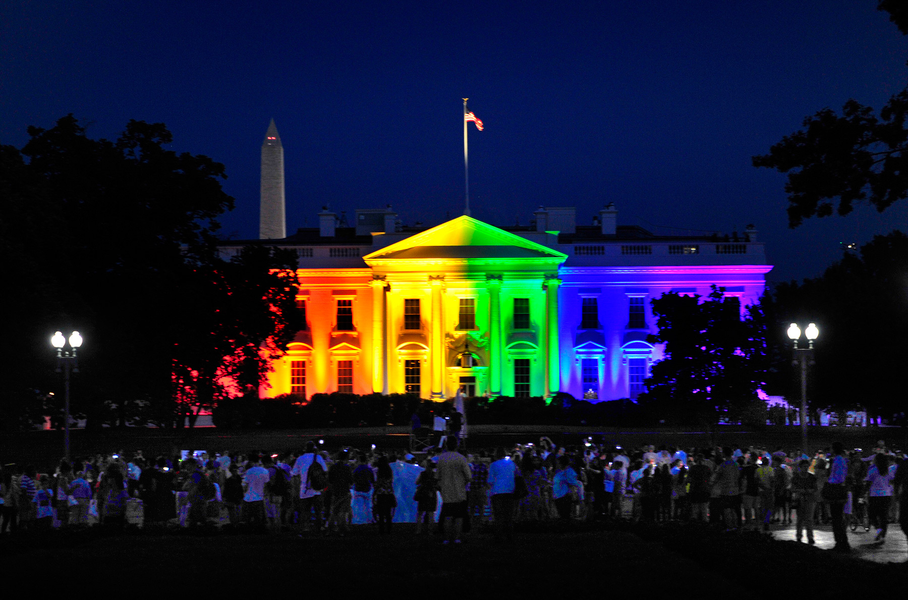 WASHINGTON, DC- JUNE 26: Lots of folks with mobile phones take photos tonight of the colorful White House.The White House was lit in multi-colored lights tonight to honor the Supreme Court decision to allow gay marriage. Michael S. Williamson/The Washington Post via Getty Images)