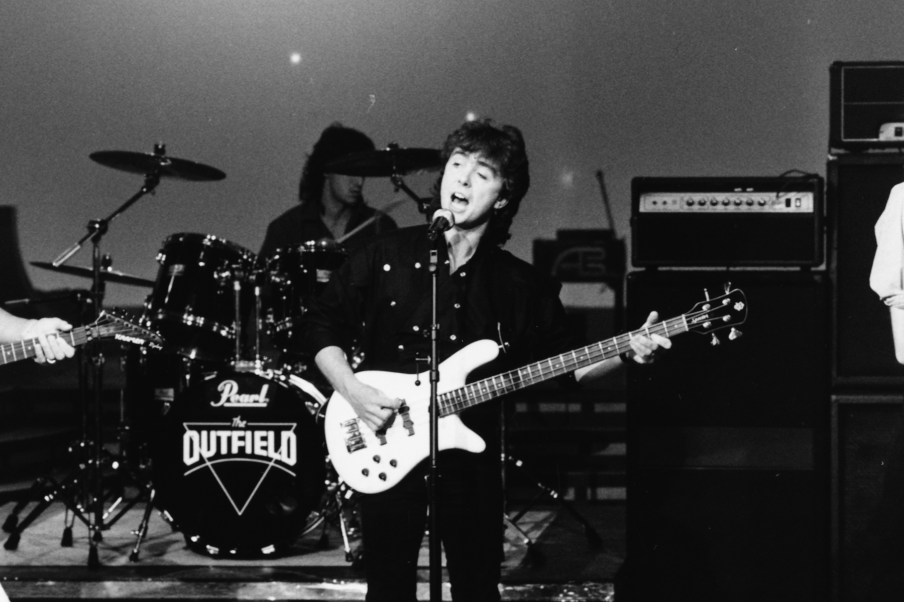 Band 'The Outfield' on stage; (L-R) John Spinks, Tony Lewis and Alan Shadrake, May 28th 1986. (Photo by Dave Hogan/Getty Images) *** Local Caption ***