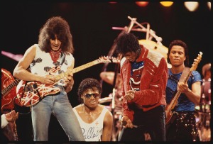 Eddie Van Halen plays guitar on stage with Randy Jackson, Michael Jackson and Jermaine Jackson during the Victory Tour. (Photo by Lynn Goldsmith/Corbis/VCG via Getty Images)