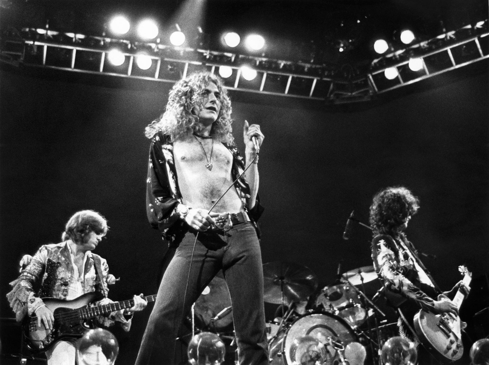 L-R: John Paul Jones, Robert Plant, Jimmy Page performing live onstage at Earls Court in London on May 24th, 1975.