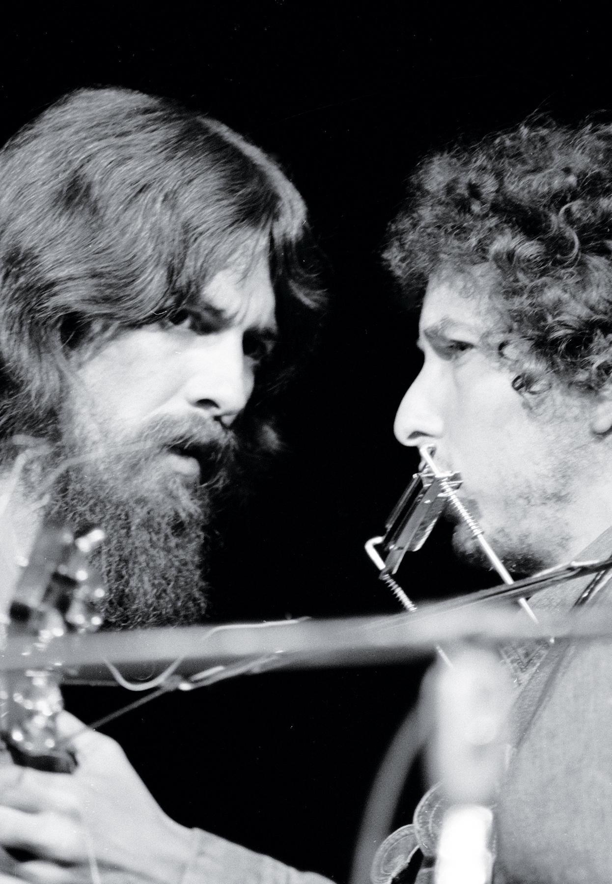 British musician George Harrison (1943 - 2001) (left) and American musician Bob Dylan performs on stage during the Concert For Bangla Desh at Madison Square Garden, New York, New York, August 1, 1971. Harrison organized the event as a benefit to the Bengali people left homeless by war. (Photo by Bill Ray/The LIFE Picture Collection via Getty Images)