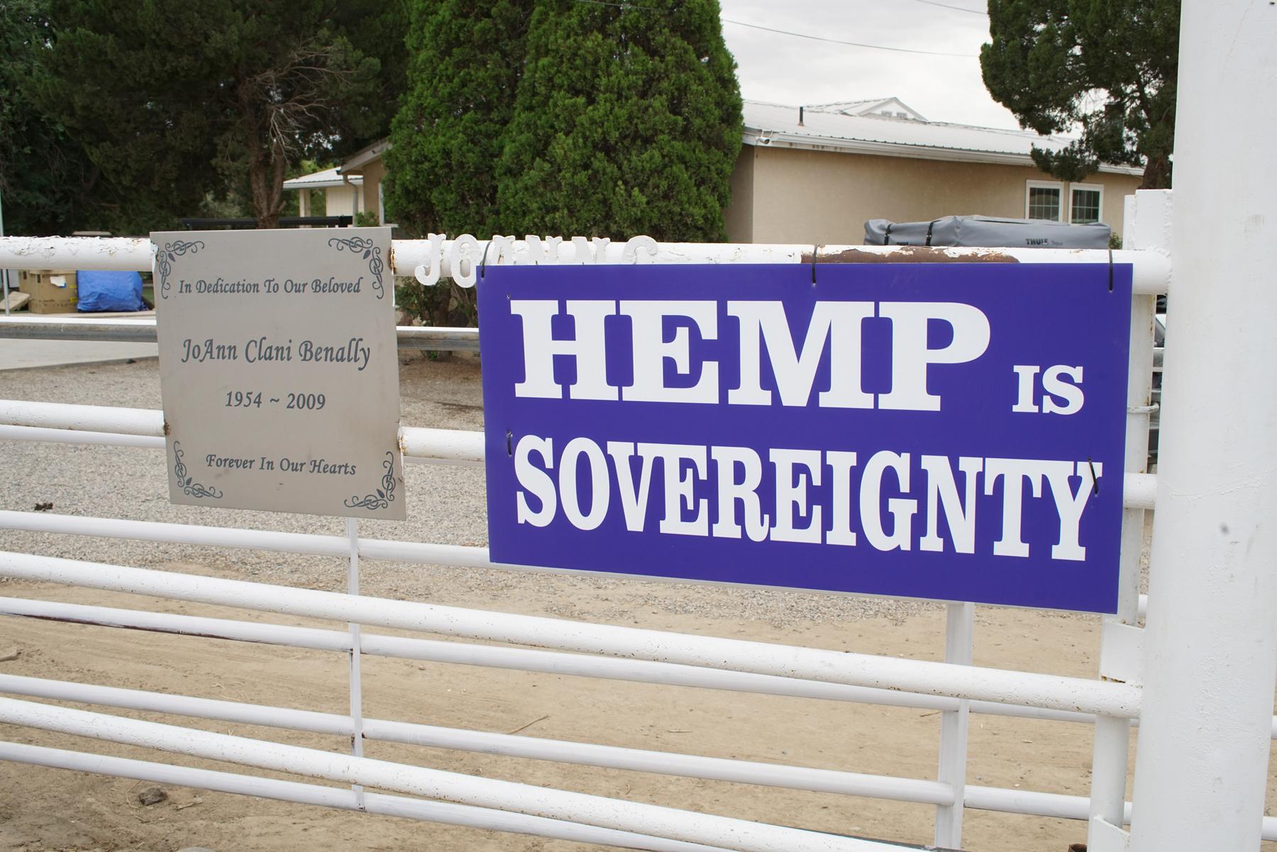 Signs supporting hemp farming along hemp fields at Dineh Benally's family home.