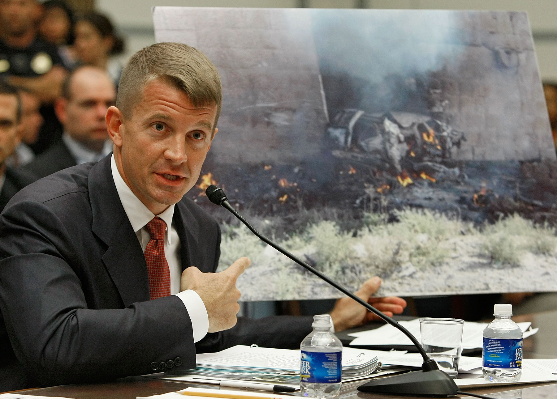 WASHINGTON - OCTOBER 02: Erik Prince, chairman of the Prince Group, LLC and Blackwater USA, holds up a picture showing the affect of a car bomb while testifying during a House Oversight and Government Reform Committee hearing on Capitol Hill October 2, 2007 in Washington DC. The committee is hearing testimony from officials regarding private security contracting in Iraq and Afghanistan. (Photo by Mark Wilson/Getty Images)