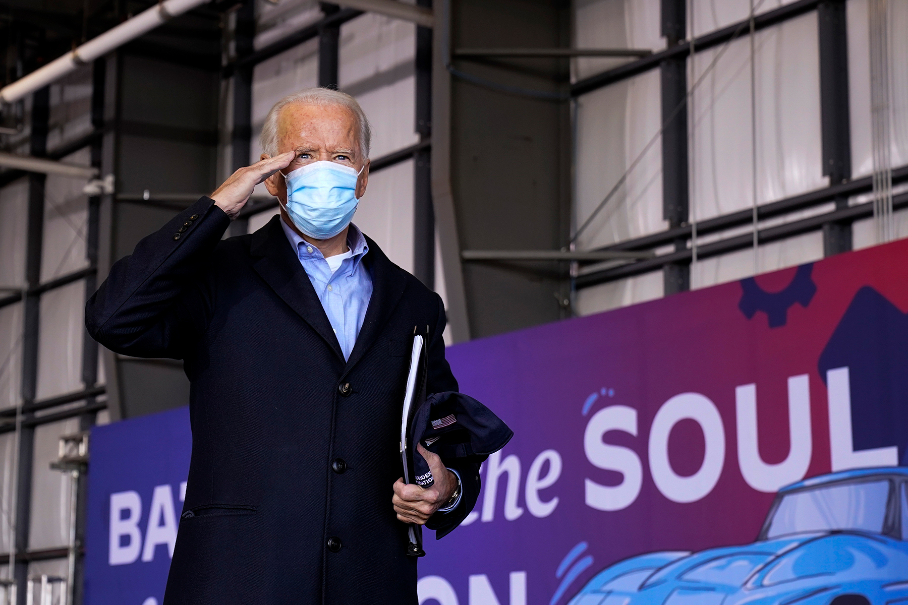 Democratic presidential candidate former Vice President Joe Biden salutes after speaking at a rally at Cleveland Burke Lakefront Airport, Monday, Nov. 2, 2020, in Cleveland. (AP Photo/Andrew Harnik)
