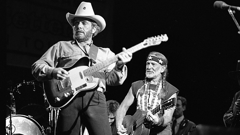 Country musician Merle Haggard performs with a Fender Telecaster with Willie Nelson in August 26, 1988. (Photo by Beth Gwinn/Getty Images)