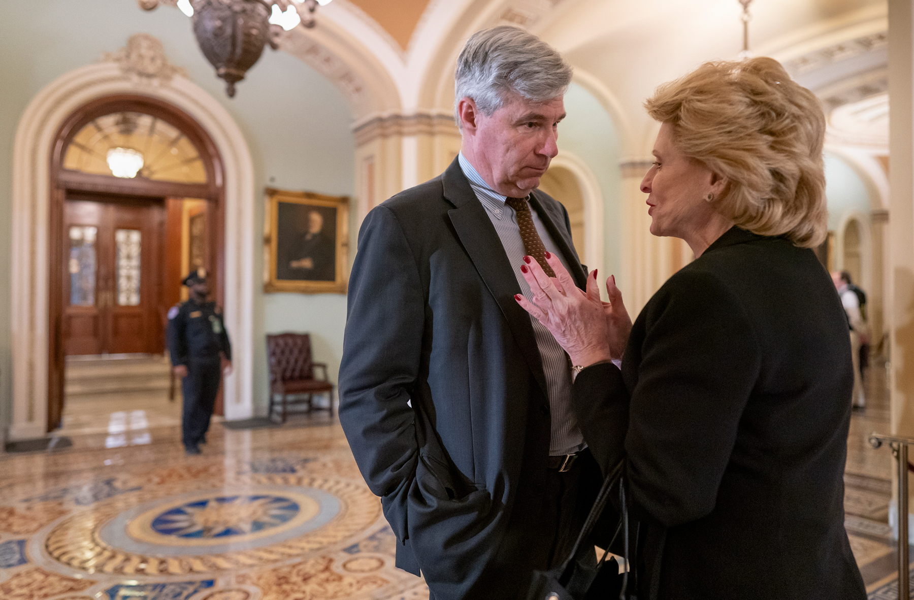 Sen. Debbie Stabenow, D-Mich., right, and Sen. Sheldon Whitehouse, D-R.I., have a private conversation outside the Senate chamber at the Capitol in Washington, Tuesday, Feb. 4, 2020. The Republican-controlled Senate is expected to acquit President Donald Trump tomorrow on impeachment charges of abuse of power and obstruction of Congress. (AP Photo/J. Scott Applewhite)