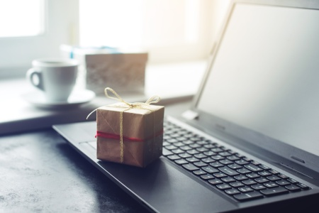 views of gift box and laptop, the concept of e-shopping